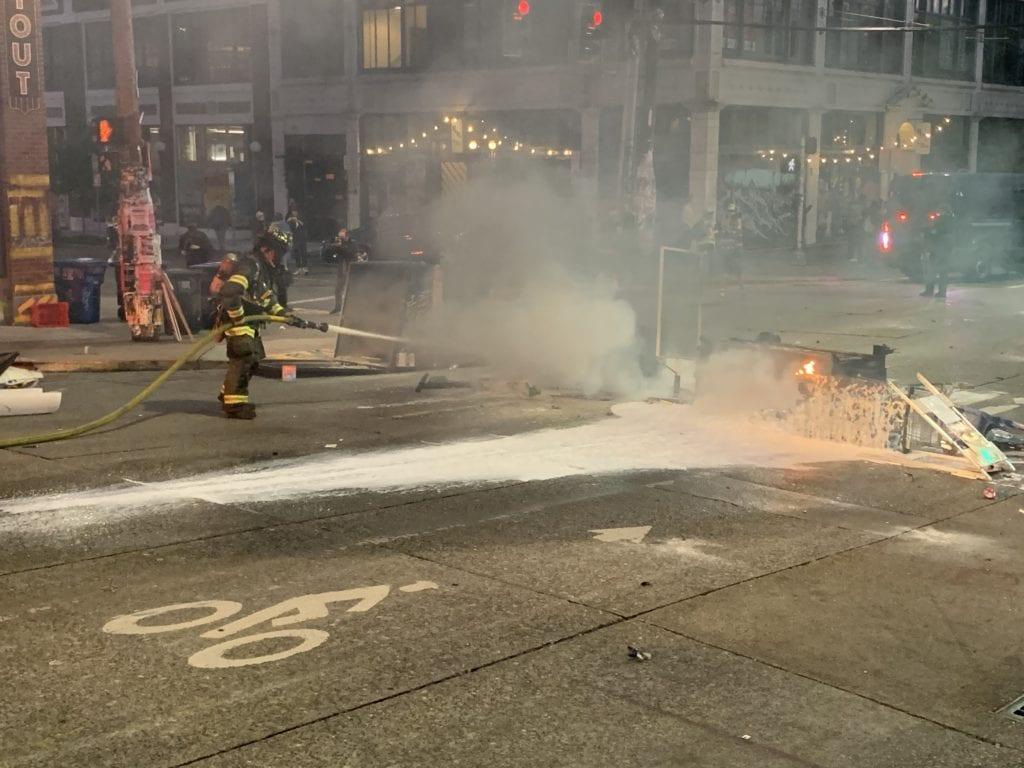 Fire department extinguishes fire set by demonstrators/SPD Blotter
