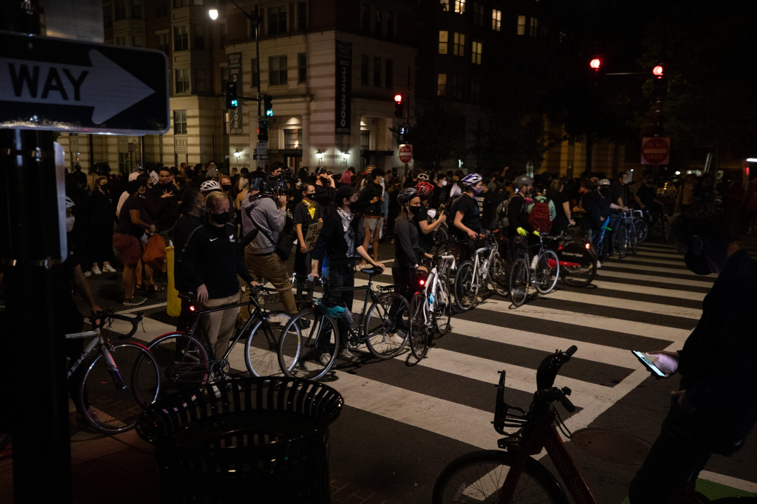 Protesters formed their own bike line to keep Metropolitan Police Officers from getting too close to people on foot in Washington, D.C. on Sept. 23. (Photo: Kaylee Greenlee / DCNF)