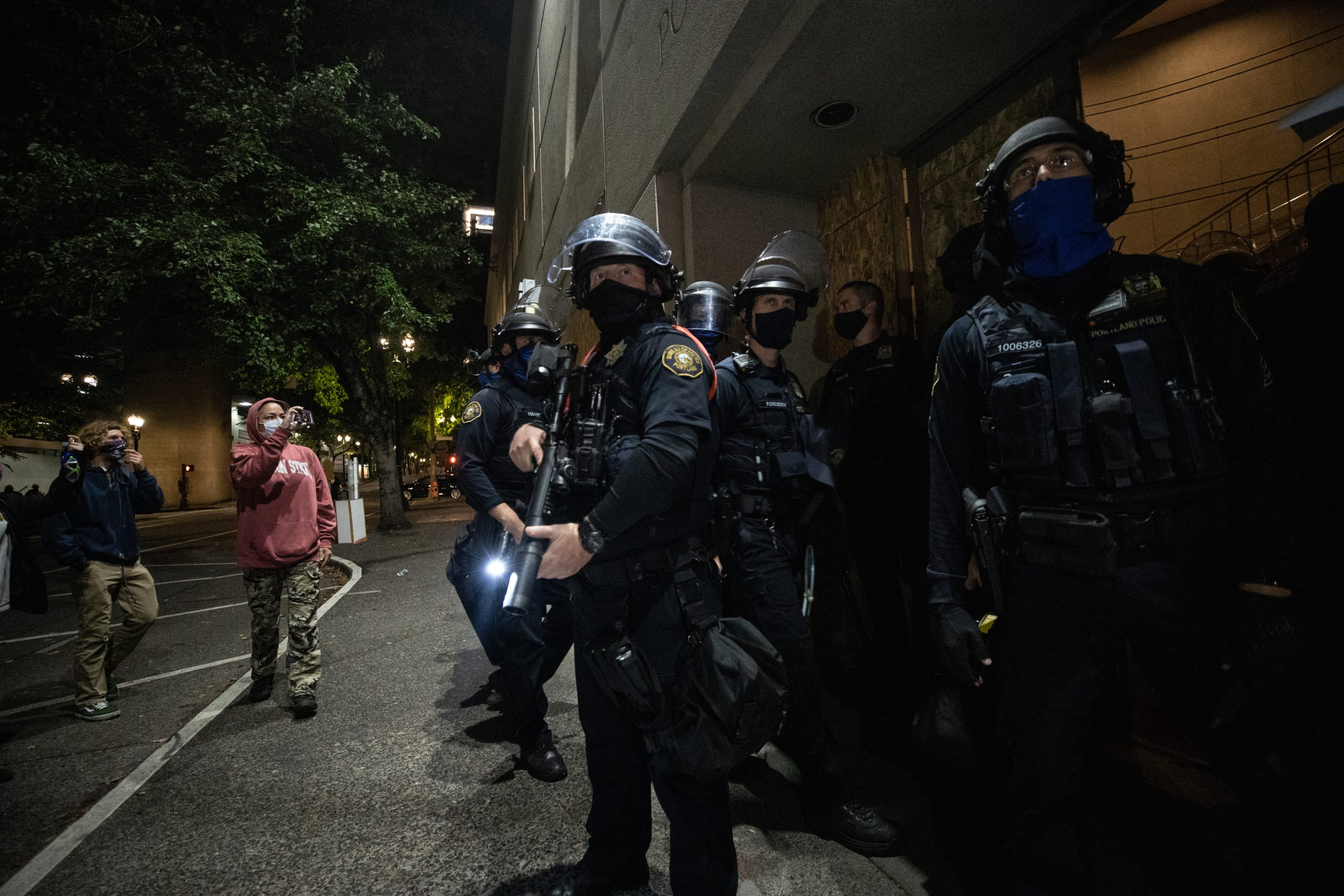 Police back into the Portland Police Bureau in Portland, Oregon, on Sept. 27, 2020. (Photo: Kaylee Greenlee / DCNF)