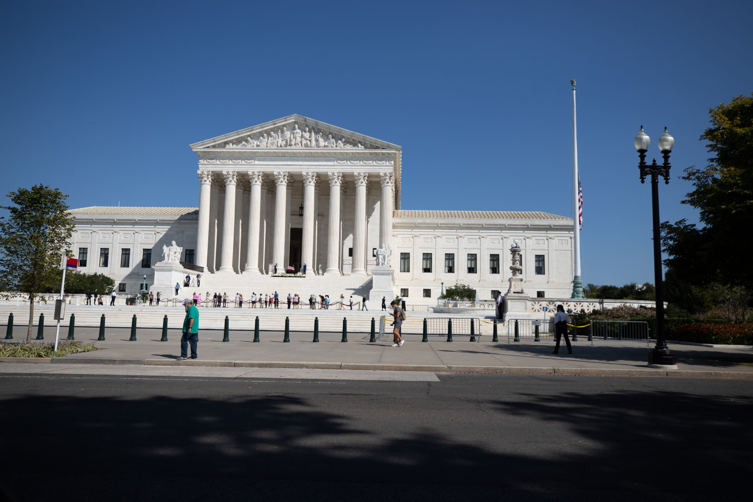 Ruth Bader Ginsburg's flag-draped casket lies in repose on the steps of the Supreme Court for the public to pay respects on Sept. 23, 2020. (Photo: Kaylee Greenlee / DCNF)