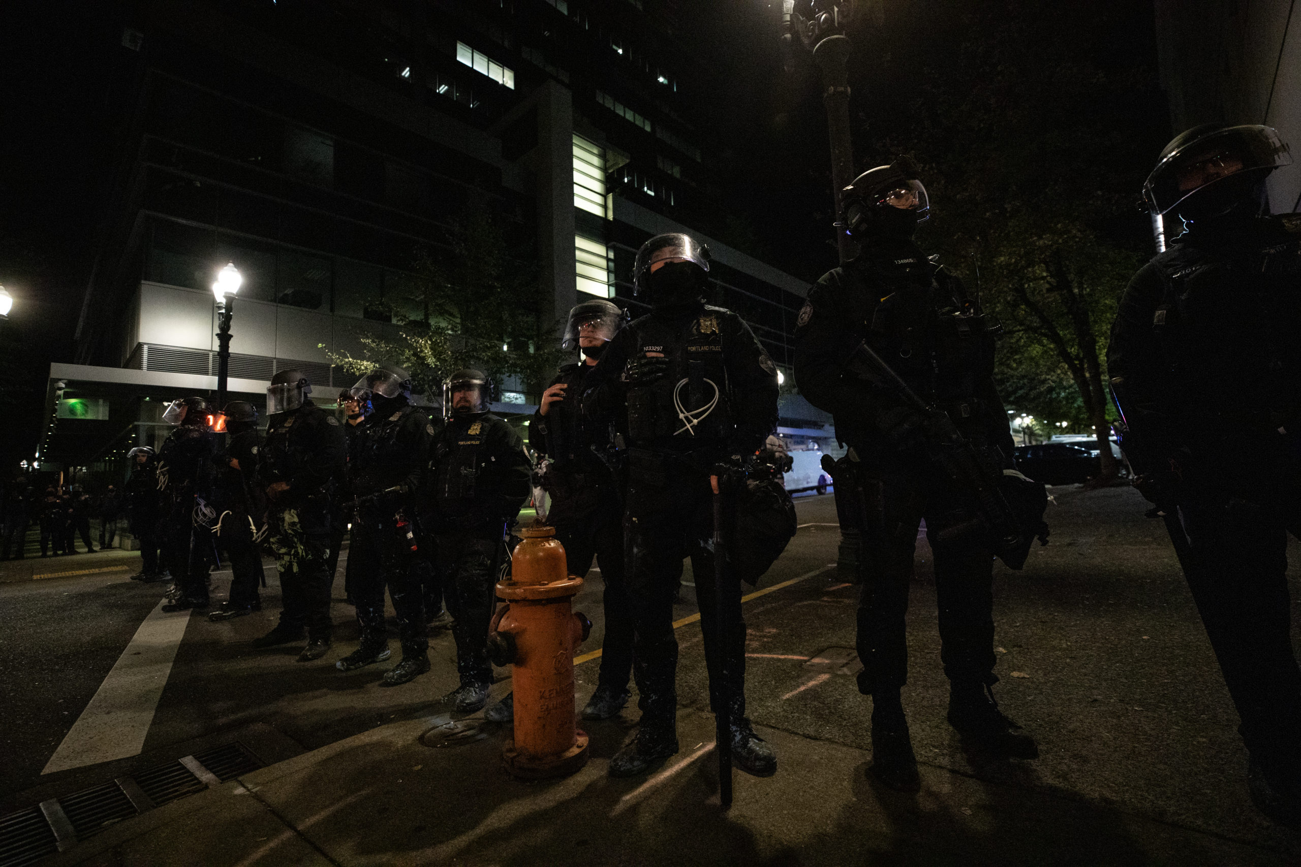Police form a line outside the Portland Police Bureau in Portland, Oregon, on Sept. 27, 2020. (Photo: Kaylee Greenlee / DCNF)