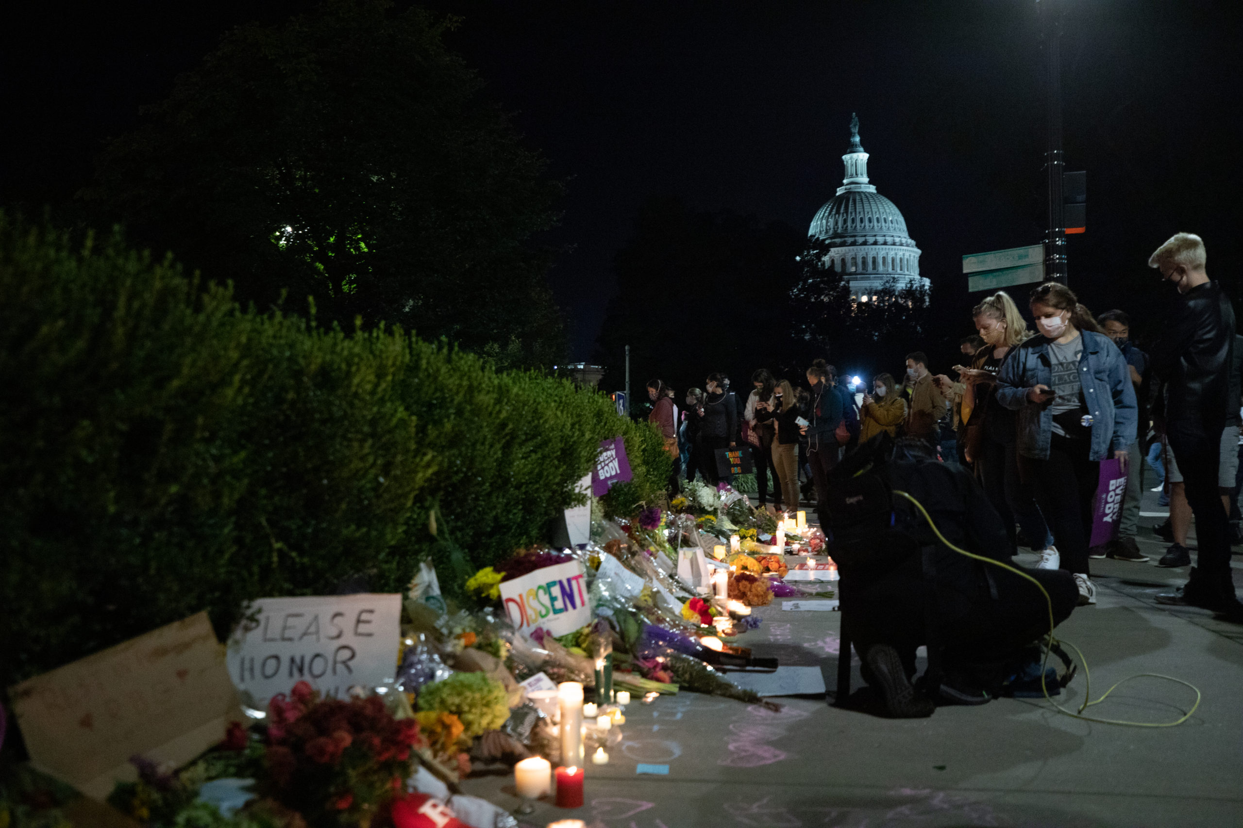 Mourners place candles, flowers, signs, and other memorabilia outside the Supreme Court at a memorial honoring the late Justice Ruth Bader Ginsburg on Sept. 19, 2020. (Photo: Kaylee Greenlee / The DCNF)