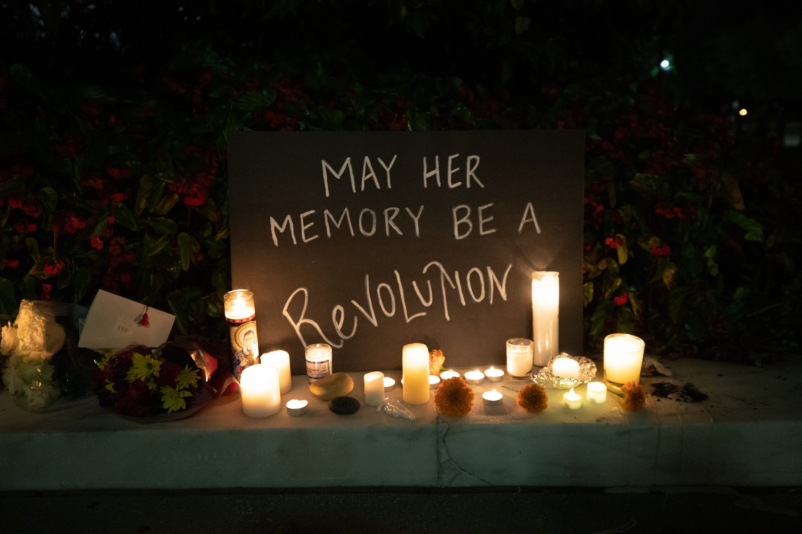 """People placed hundreds of signs reading """"may her memory be a revolution,"""" """"when there are nine,"""" and """"I dissent"""" at a memorial honoring the late Justice Ruth Bader Ginsburg on Sept. 19, 2020. (Photo: Kaylee Greenlee / The DCNF)"""