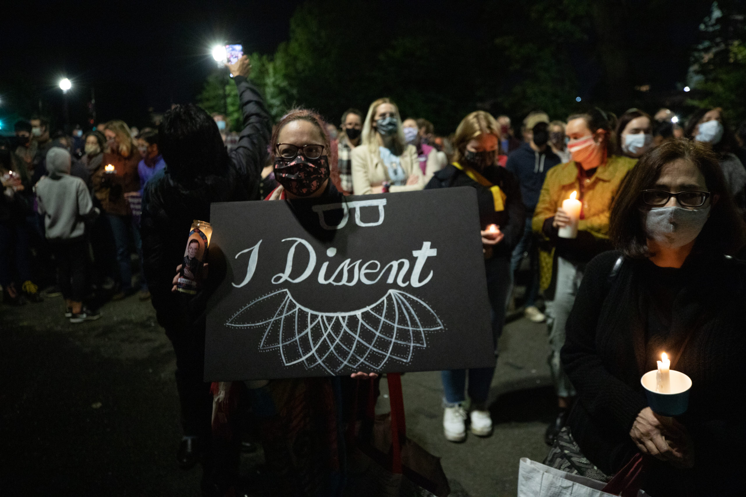 """A woman holds an """"I dissent"""" sign outside the Supreme Court at a memorial honoring the late Justice Ruth Bader Ginsburg on Sept. 19, 2020. (Photo: Kaylee Greenlee / The DCNF)"""