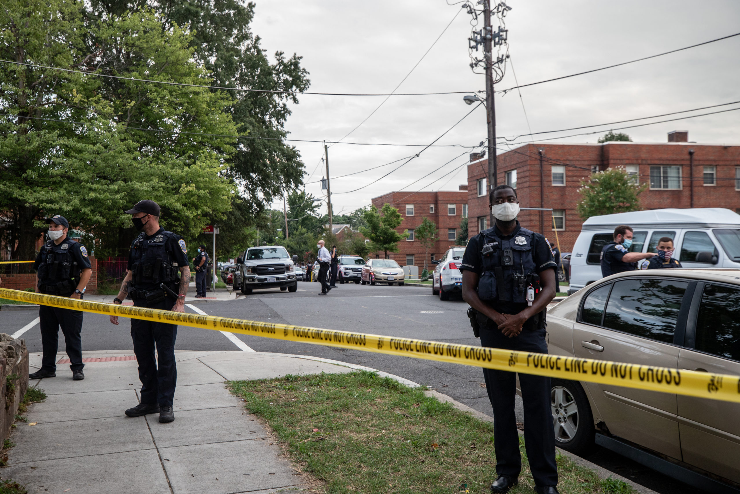 Police block off a crime scene in southeast Washington D.C. where a Metropolitan Police Department officer fatally shot a young black man. (Kaylee Greenlee/Daily Caller News Foundation)