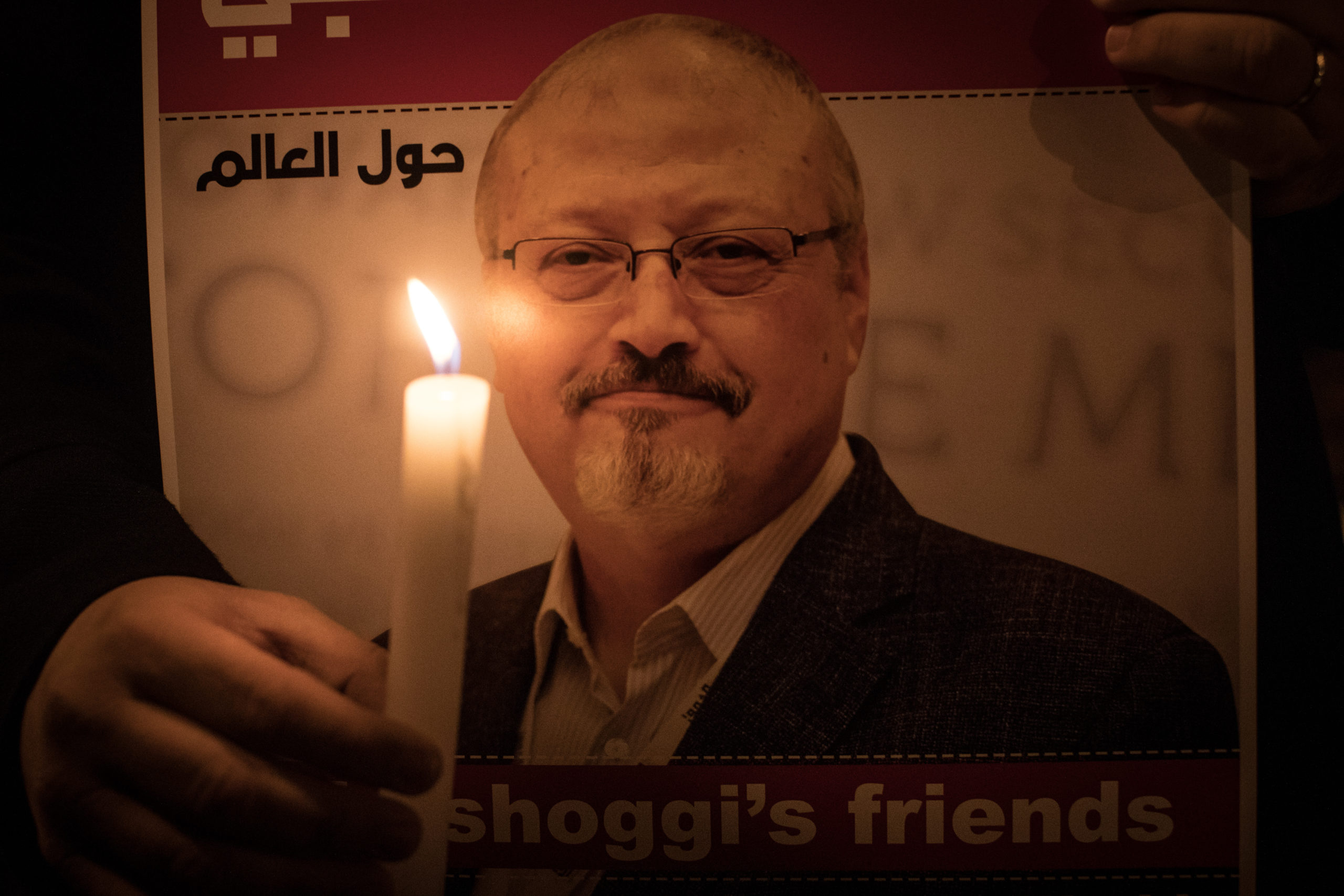 People take part in a candle light vigil to remember journalist Jamal Khashoggi outside the Saudi Arabia consulate Turkey. (Chris McGrath/Getty Images)