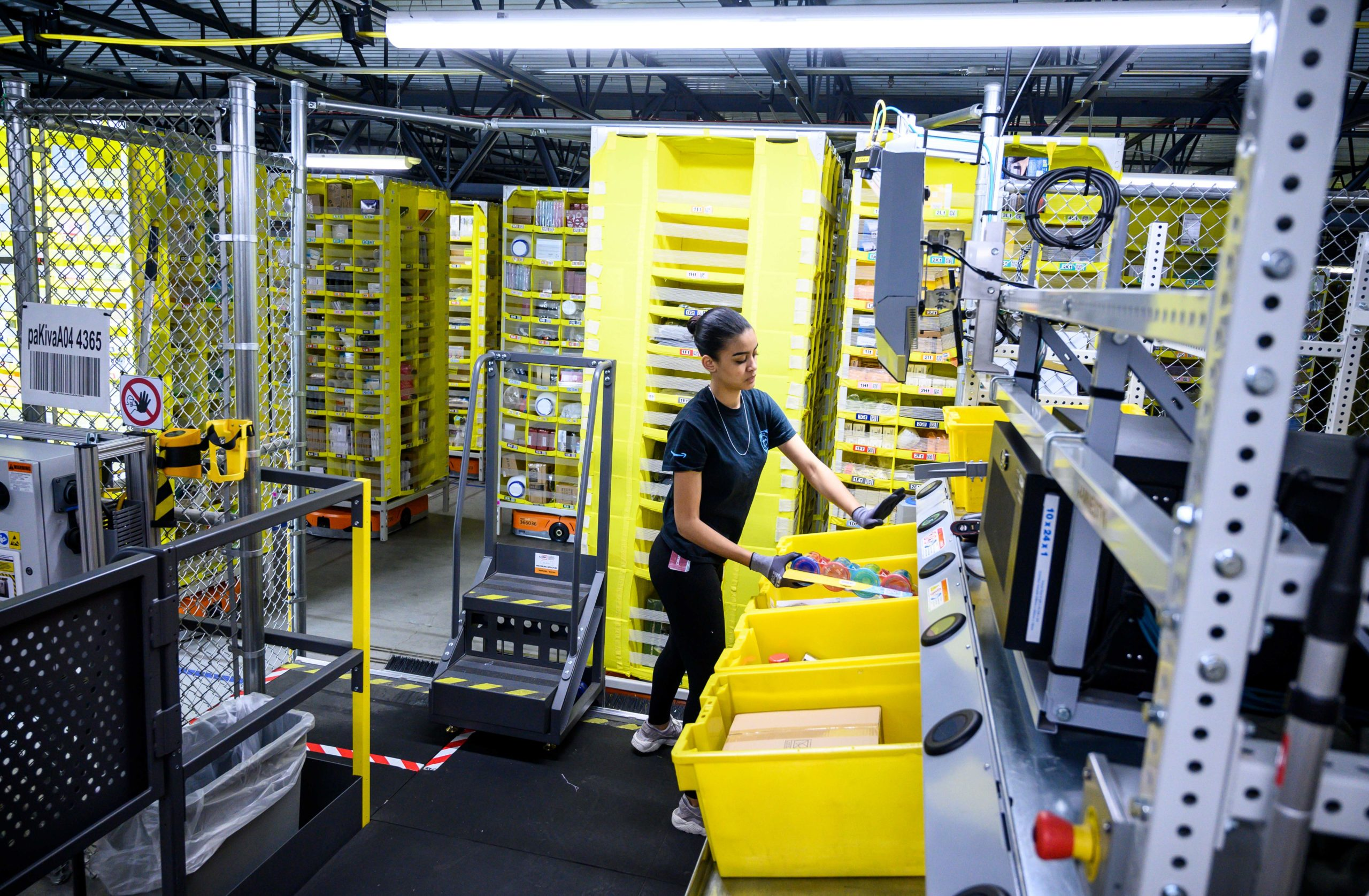 A woman works at a distribution station at the 855,000-square-foot Amazon fulfillment center in Staten Island, New York in 2019. (Johannes Eisele/AFP via Getty Images)