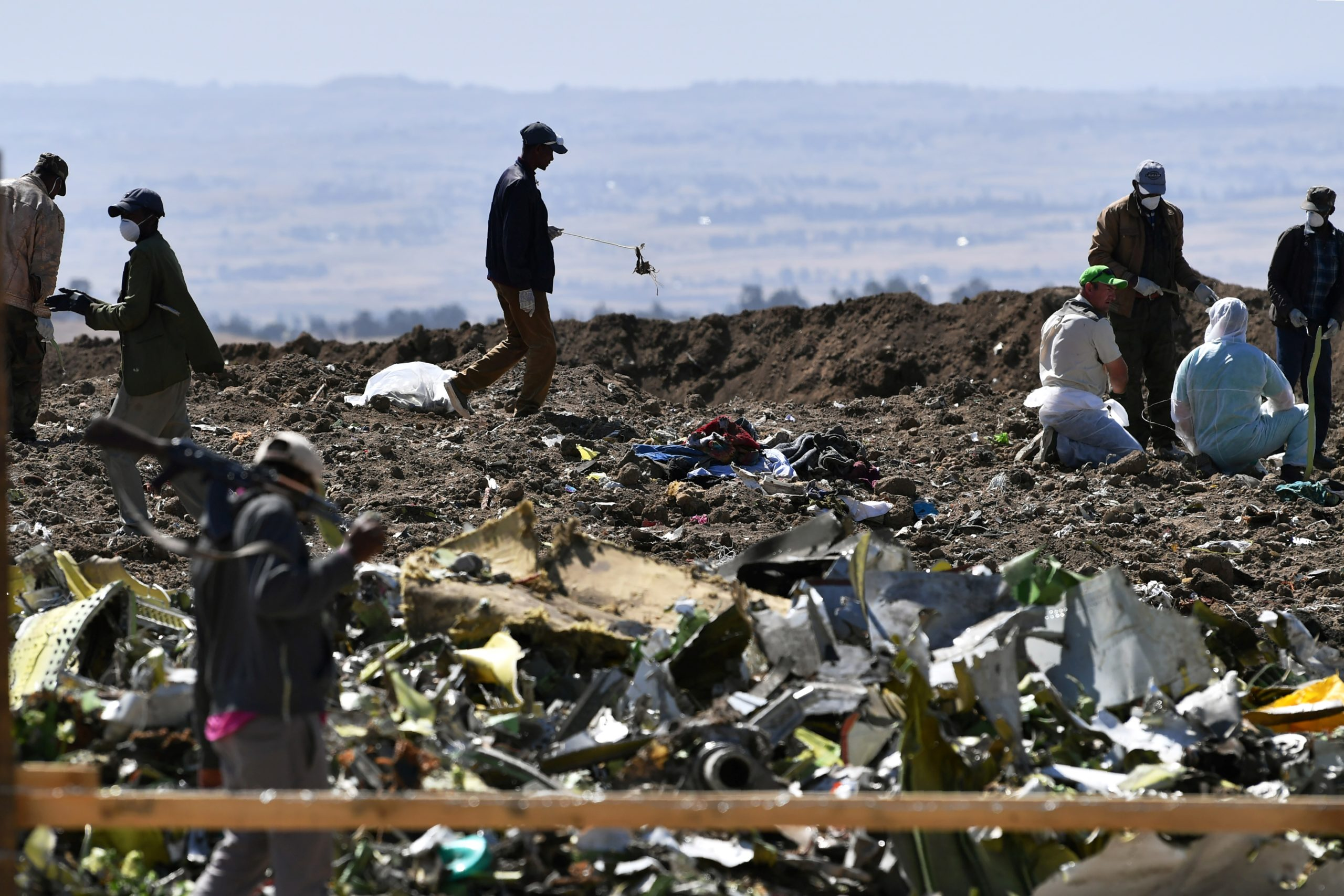 Oromo men hired to assist forensic investigators are at work at the crash site of an Ethiopian airways operated Boeing 737 MAX aircraft on March 16, 2019 at Hama Quntushele village near Bishoftu in Oromia region. - A French investigation into the March 10 Nairobi-bound Ethiopian Airlines Boeing 737 MAX crash that killed 157 passengers and crew opened on March 15 as US aerospace giant Boeing stopped delivering the top-selling aircraft. (Photo by TONY KARUMBA / AFP) (Photo credit should read TONY KARUMBA/AFP via Getty Images)