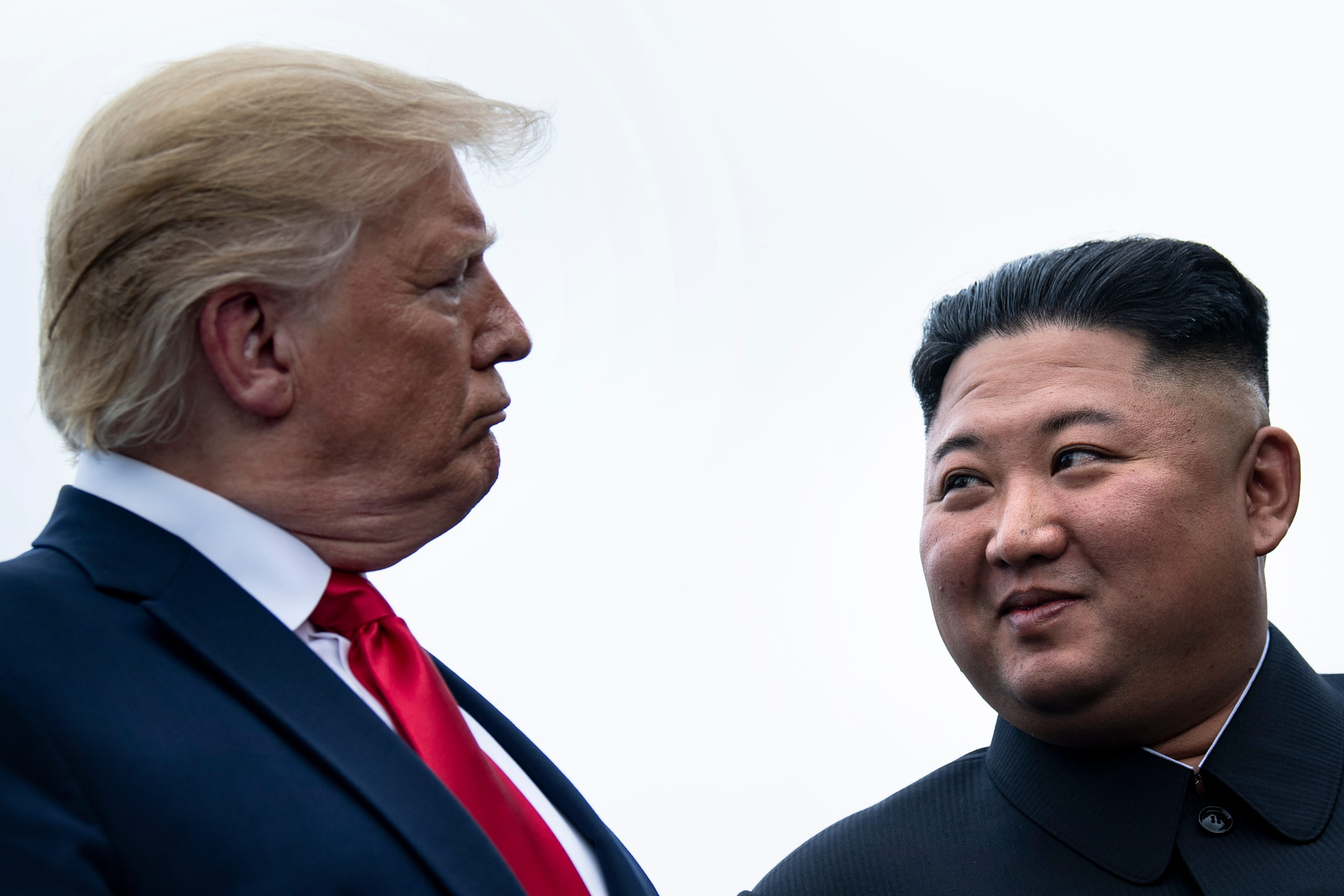 TOPSHOT - US President Donald Trump and North Korea's leader Kim Jong-un talk before a meeting in the Demilitarized Zone(DMZ) on June 30, 2019, in Panmunjom, Korea. (Photo by Brendan Smialowski / AFP)