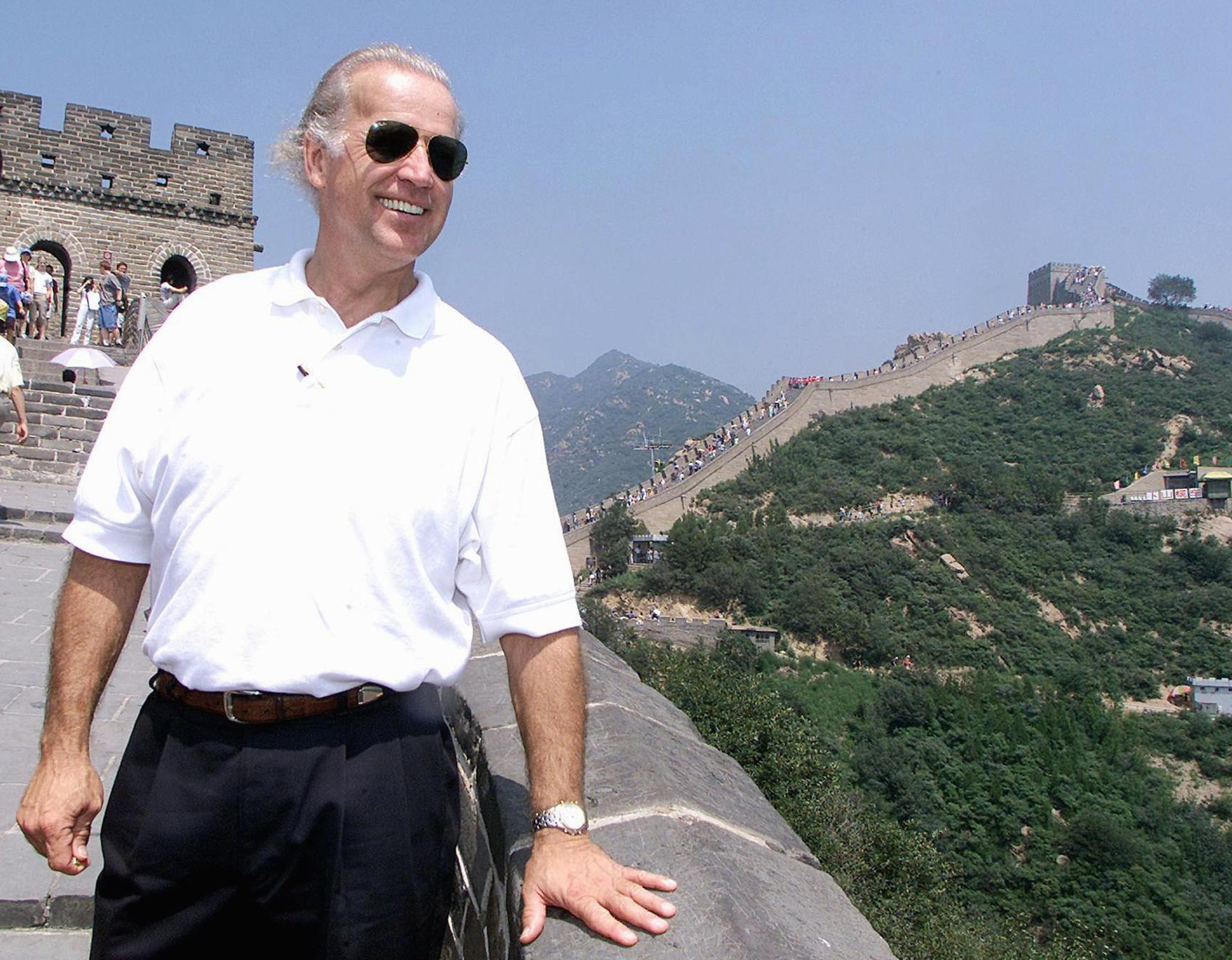 US Senate Foreign Relations Committee Chairman Joseph Biden visits the Great Wall of China at Badaling, north of Beijing, 10 August 2001. After meeting Chinese leaders for two days, Biden and his delegation left Beijing to meet with villagers and visit the Great Wall. AFP PHOTO/POOL (Photo by Greg Baker / POOL / AFP) (Photo by GREG BAKER/POOL/AFP via Getty Images)