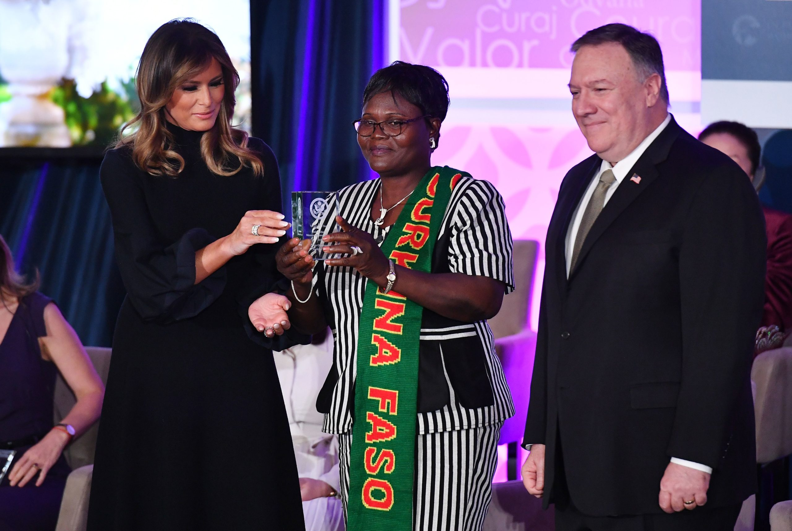 International Women of Courage (IWOC) Award recipient Claire Ouedraogo of Burkina Faso poses with US Secretary of State Mike Pompeo and First Lady Melania Trump at the State Department in Washington, DC on March 4, 2020. (Mandel Ngan/AFP via Getty Images)