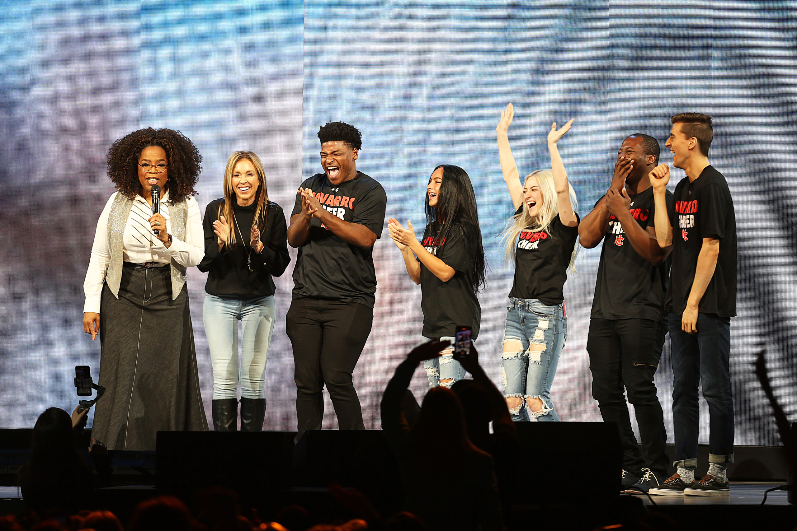 """DALLAS, TX - FEBRUARY 15: Oprah Winfrey speaks with the cast of Netflix's """"Cheer"""", (L-R) Monica Aldama, Jerry Harris, Gabi Butler, Lexi Brumback, TT Barker and Dillon Brandt during Oprah's 2020 Vision: Your Life in Focus Tour presented by WW (Weight Watchers Reimagined) at American Airlines Center on February 15, 2020 in Dallas, Texas. (Photo by Omar Vega/Getty Images)"""