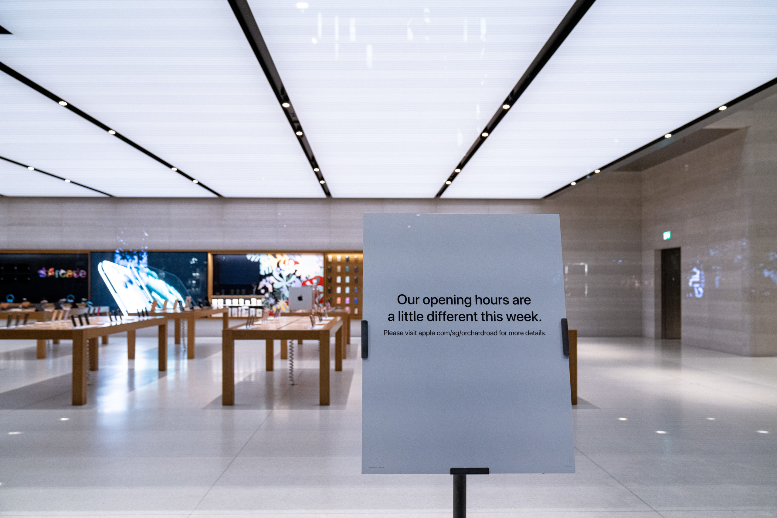A notice can be seen at the flagship Apple store on Orchard Road informing customers of its temporary closure on March 15 in Singapore. (Ore Huiying/Getty Images)