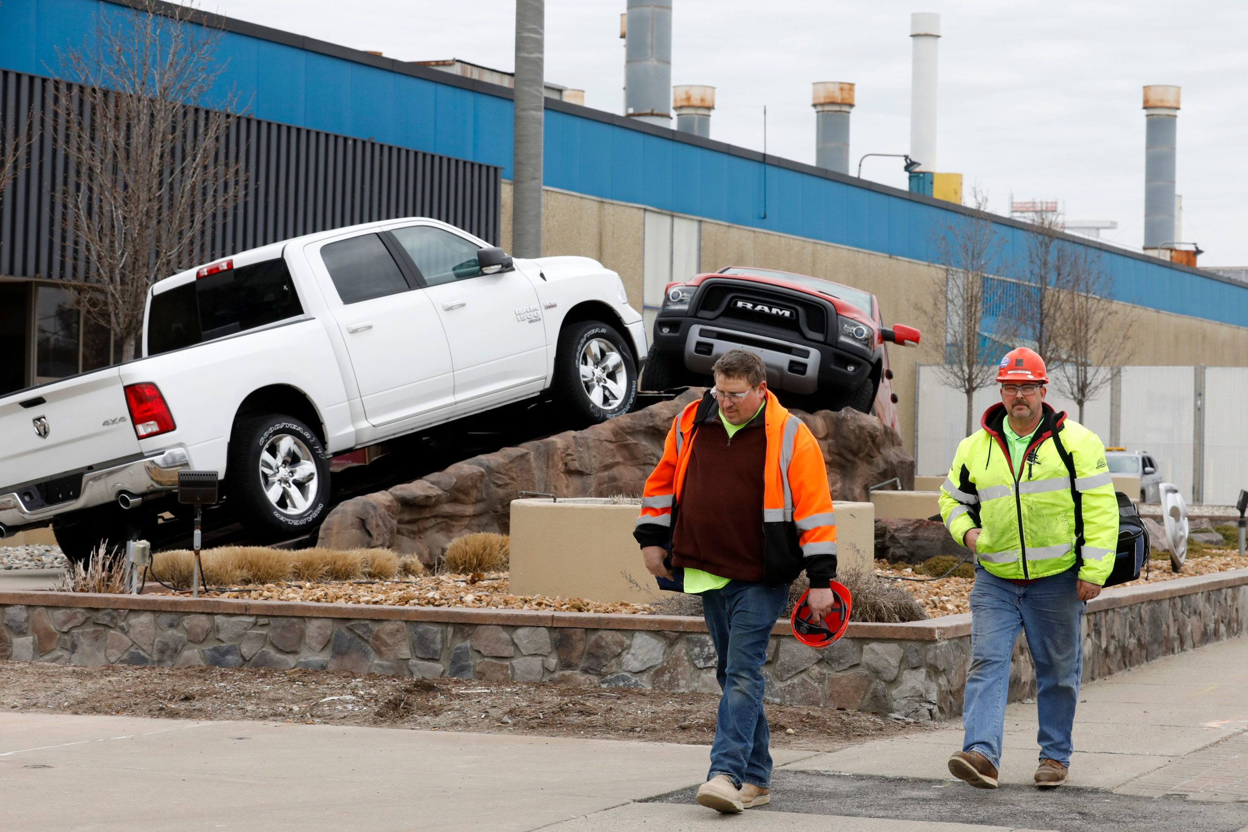 Construction workers leave Chrysler Warren Truck Assembly on March 18, 2020 in Detroit, Michigan. (Jeff Kowalsky/AFP via Getty Images)