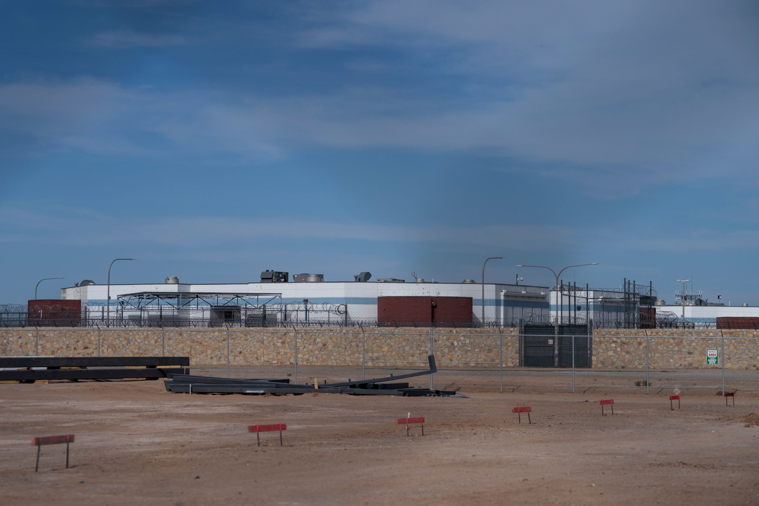 An Immigration and Customs Enforcement Processing Center is seen from a distance. (Paul Ratje/AFP/ via Getty Images)