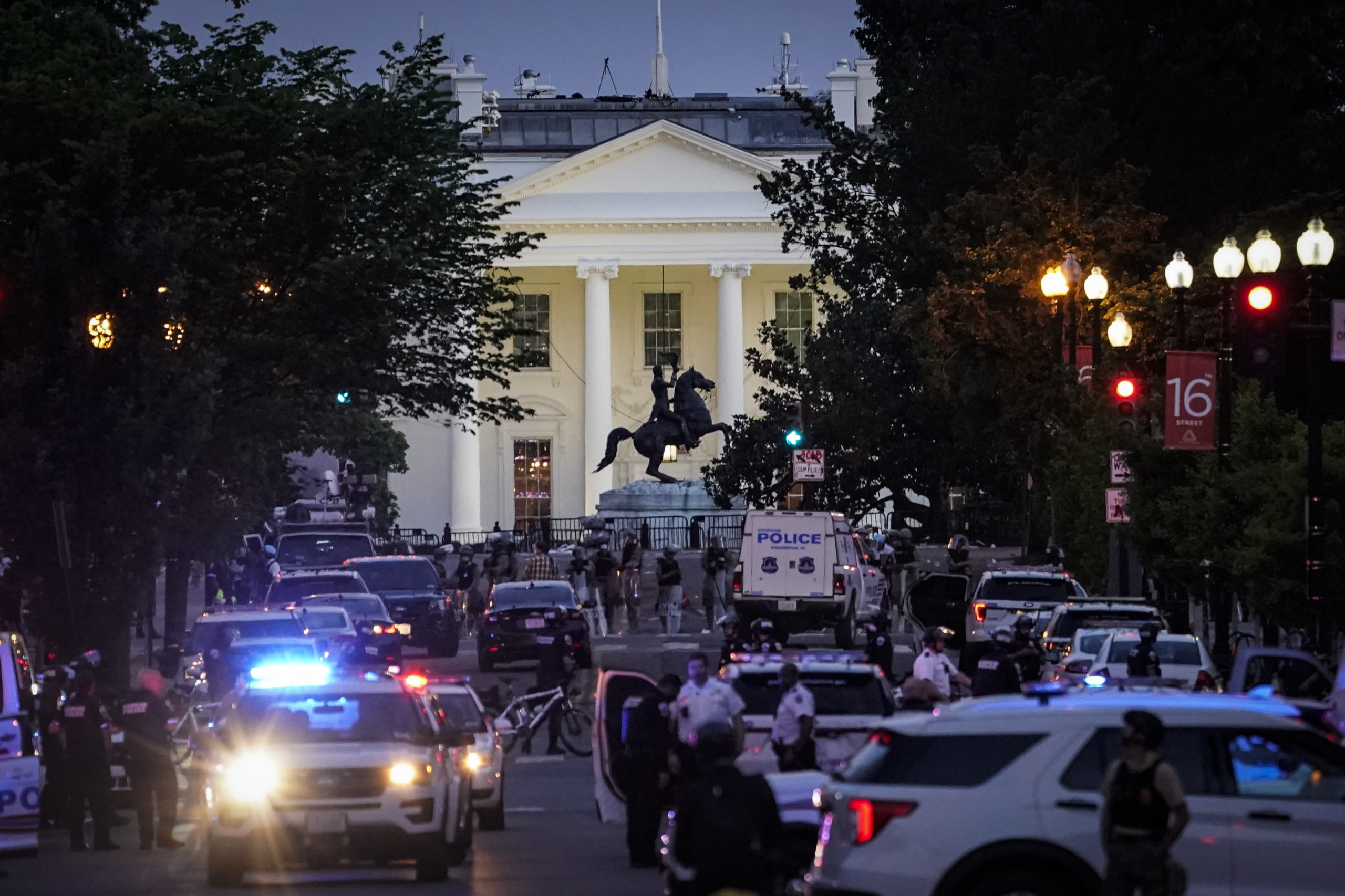 WASHINGTON, DC - JUNE 01: A large law enforcement response is seen near the White House after a protest was dispersed on June 1, 2020 in downtown Washington, DC. Protests and riots continue in cities across America following the death of George Floyd, who died after being restrained by Minneapolis police officer Derek Chauvin. Chauvin, 44, was charged last Friday with third-degree murder and second-degree manslaughter. (Photo by Drew Angerer/Getty Images)