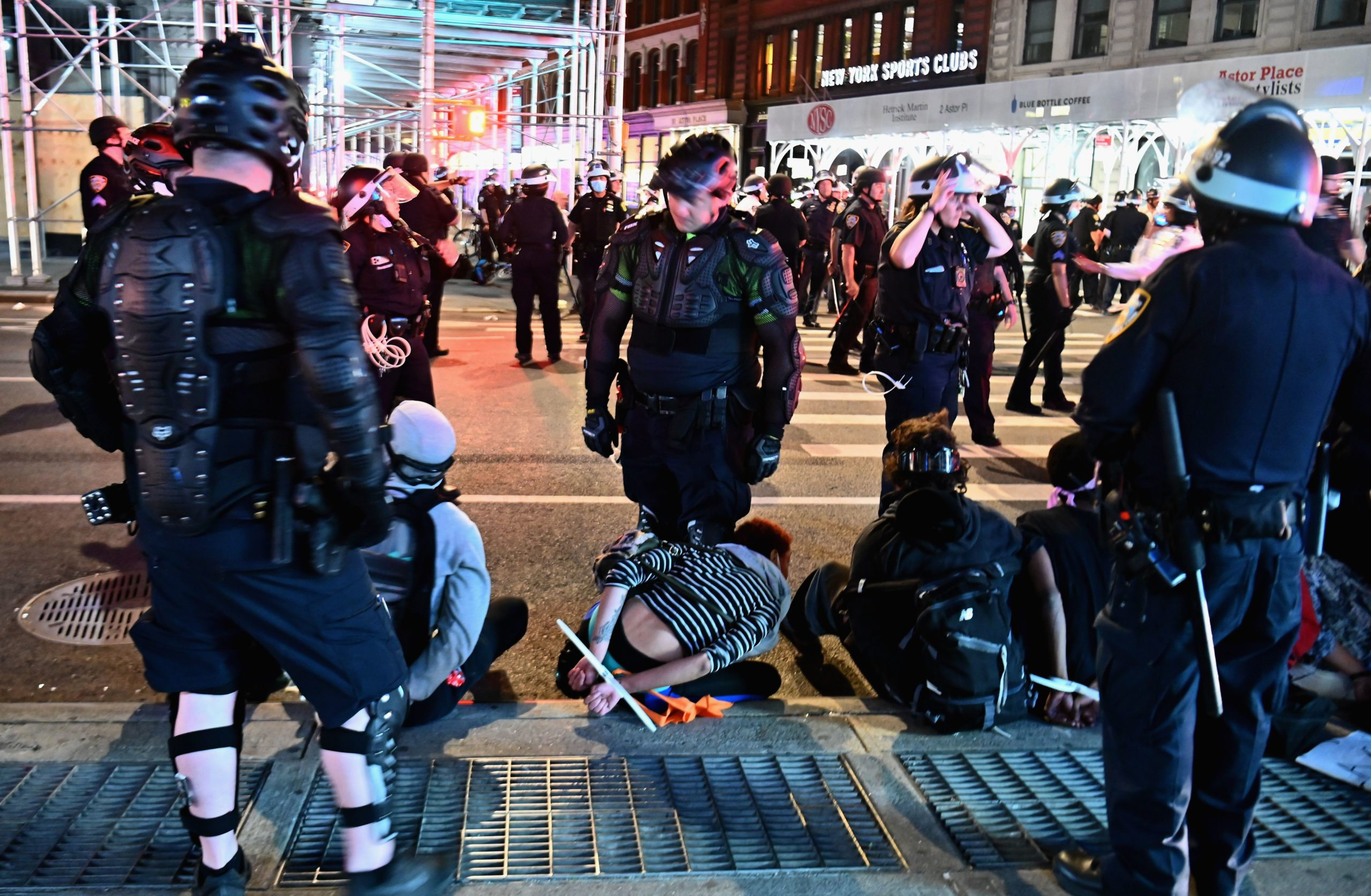 People are arrested after looting on June 2, 2020 in New York City. - Anti-racism protests have put several US cities under curfew to suppress rioting, following the death of George Floyd while in police custody. (ANGELA WEISS/AFP via Getty Images)