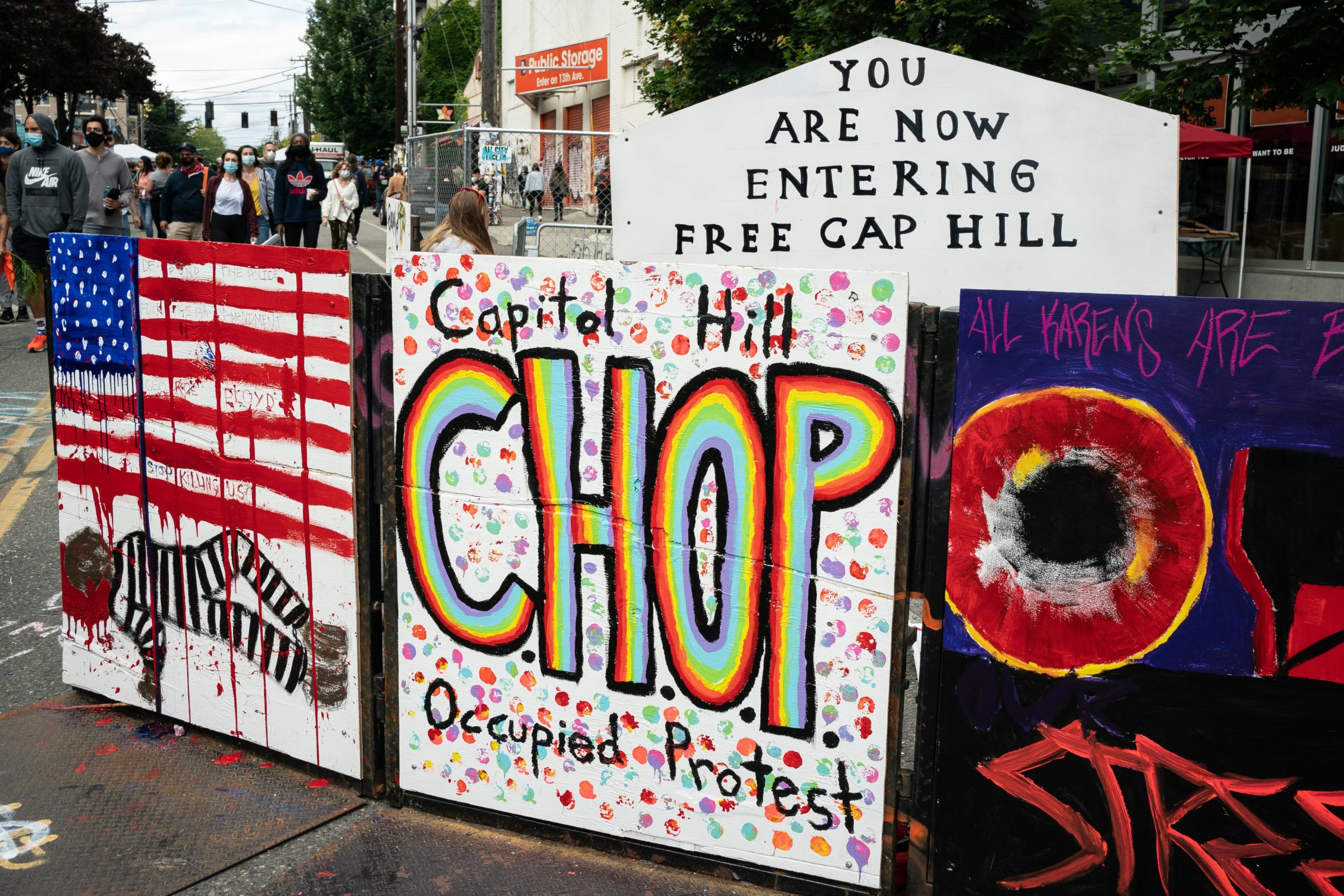 """SEATTLE, WA - JUNE 14: A signs reads """"Capitol Hill Occupied Protest"""" in area that has been referred to by protesters by that name as well as """"Capitol Hill Organized Protest, or CHOP, on June 14, 2020 in Seattle, Washington. Black Lives Matter protesters have continued demonstrating in what was first referred to as the Capitol Hill Autonomous Zone, which encompasses several blocks around the Seattle Police Departments vacated East Precinct, but what protesters are now calling the """"Capitol Hill Organized Protest."""" (Photo by David Ryder/Getty Images)"""