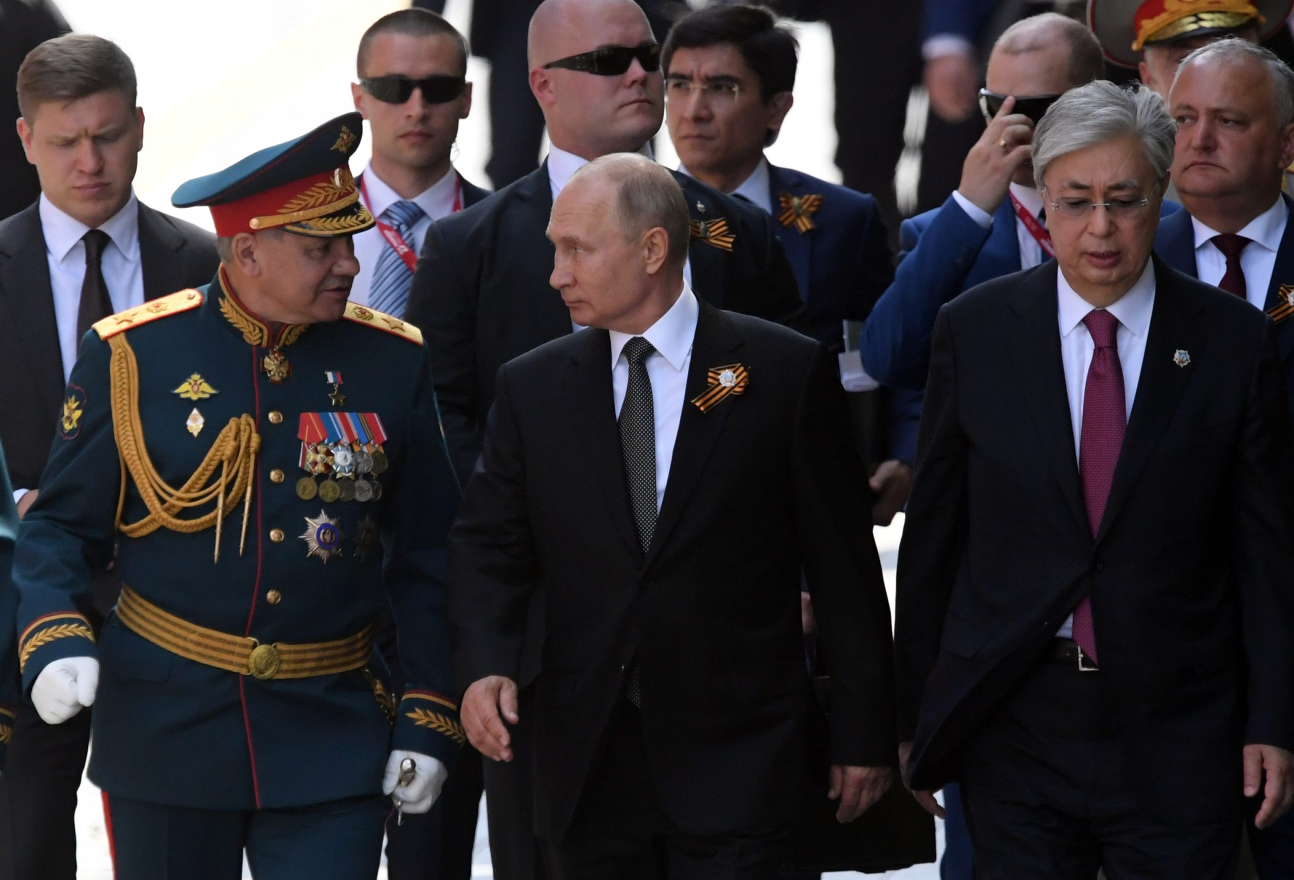 MOSCOW, RUSSIA - JUNE 24: President of Russia and Commander-in-Chief of the Armed Forces Vladimir Putin (C) and Russian Defense Minister Sergei Shoigu (L) and President of Kazakhstan Kassym-Jomart Tokayev (R) during a Victory Day military parade marking the 75th anniversary of the victory in World War II, on June 24, 2020 in Moscow, Russia. (Photo by Kirill Kallinikov - Host Photo Agency via Getty Images )