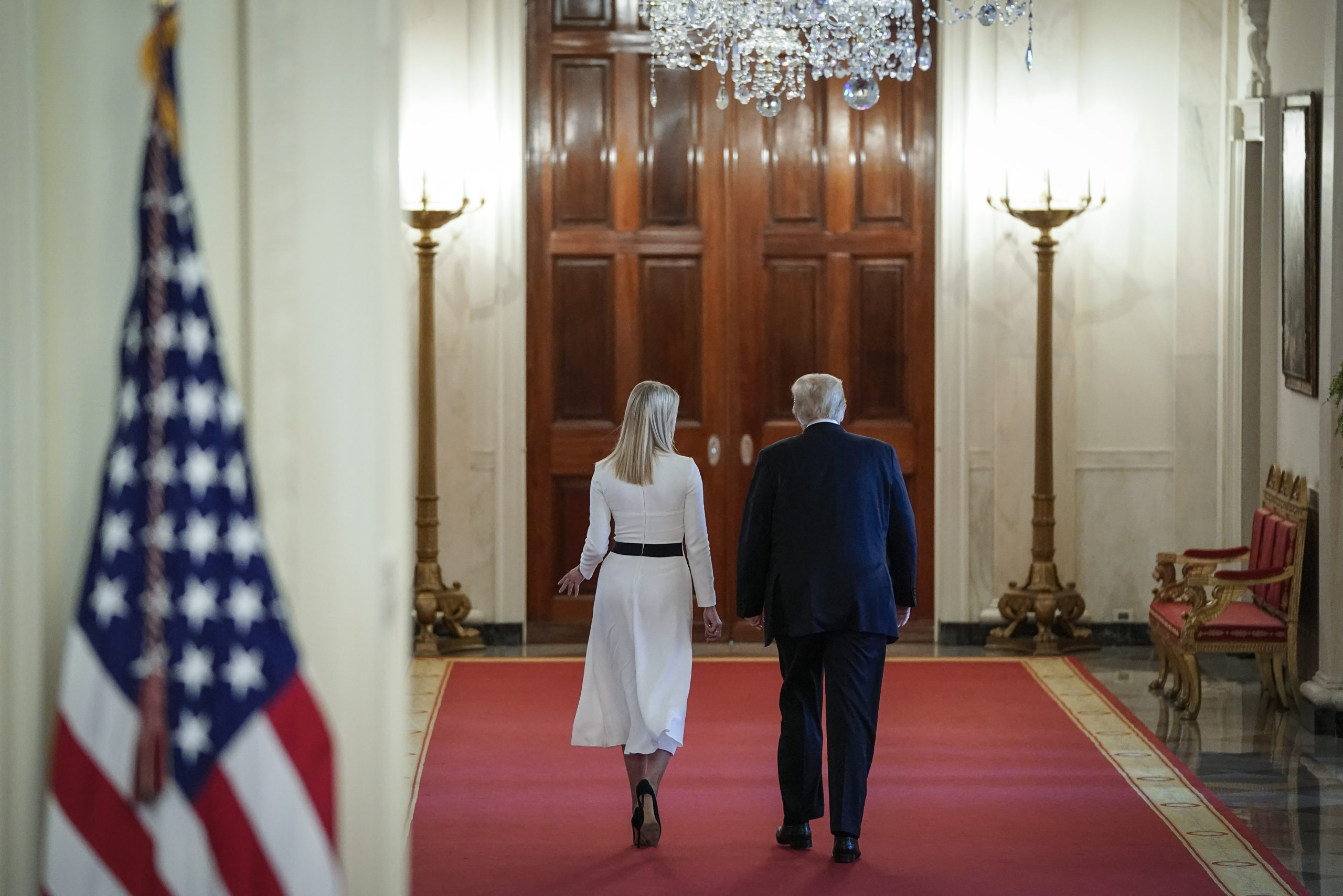 WASHINGTON, DC - JUNE 26: U.S. President Donald Trump (R) walks with White House advisor and daughter Ivanka Trump (L) as they leave a meeting of the American Workforce Policy Advisory Board in the EastRoom of the White House on June 26, 2020 in Washington, DC. Earlier in the day President Trump canceled his scheduled weekend trip to his private golf club in Bedminster, New Jersey which the state now has a mandatory 14-day quarantine for travelers coming from states with coronavirus spikes. (Photo by Drew Angerer/Getty Images)