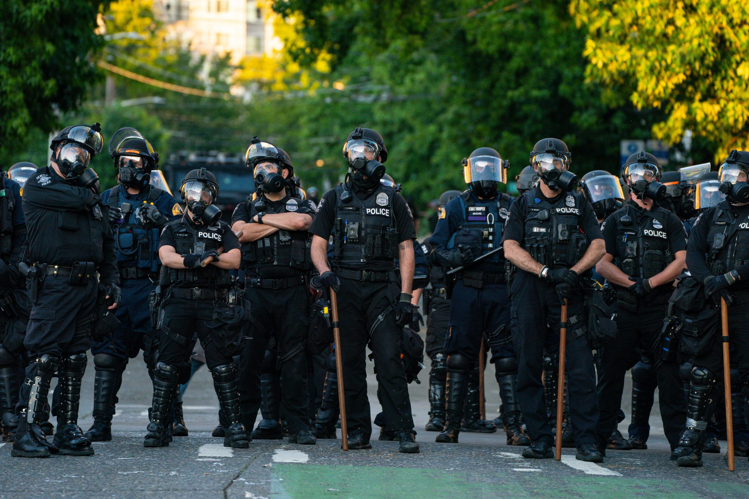 Police block a road during protests near the Seattle Police East Precinct on July 26, 2020 in Seattle, Washington. (David Ryder/Getty Images)