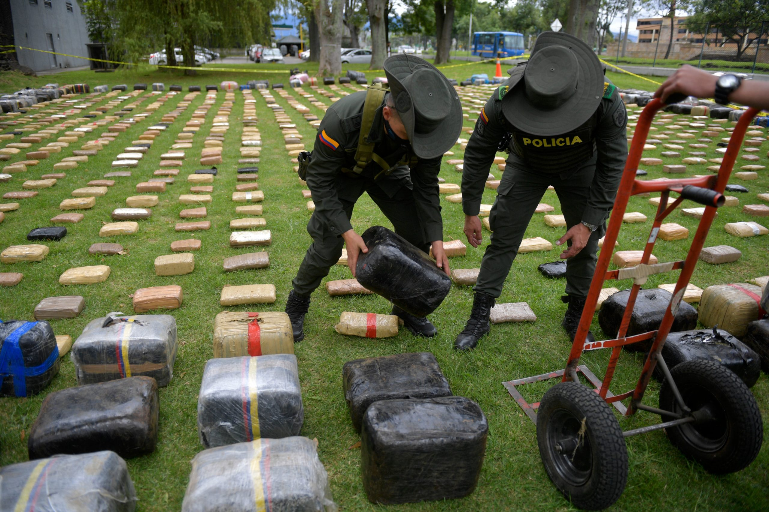Colombian police officers organize packages of seized marijuana in Bogota on August 13, 2020. (Raul Arboleda/AFP via Getty Images)