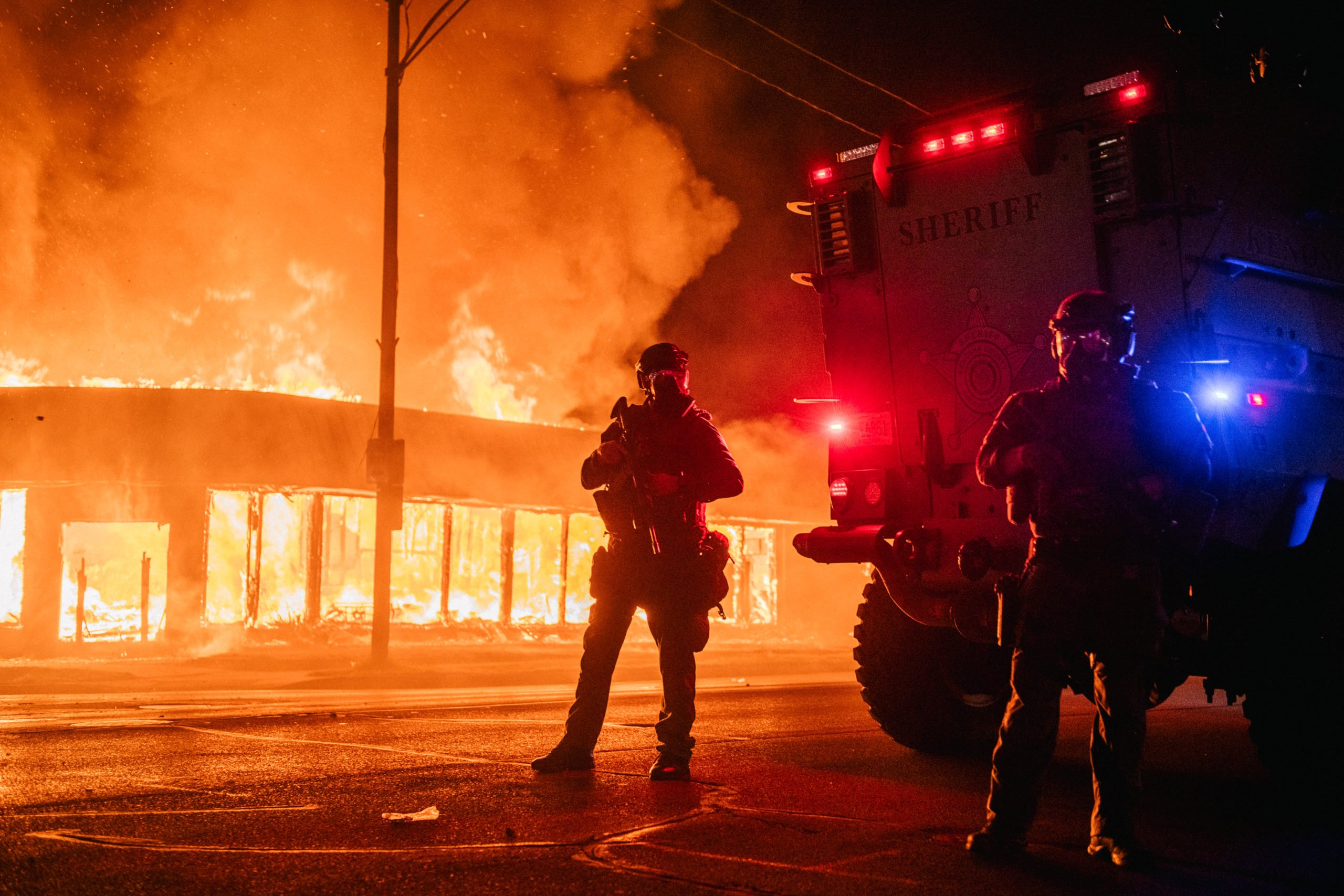 KENOSHA, WI - AUGUST 24: A police armored vehicle patrols an intersection on August 24, 2020 in Kenosha, Wisconsin. This is the second night of rioting after the shooting of Jacob Blake, 29, on August 23. Blake was shot multiple times in the back by Wisconsin police officers after attempting to enter into the drivers side of a vehicle. (Photo by Brandon Bell/Getty Images)