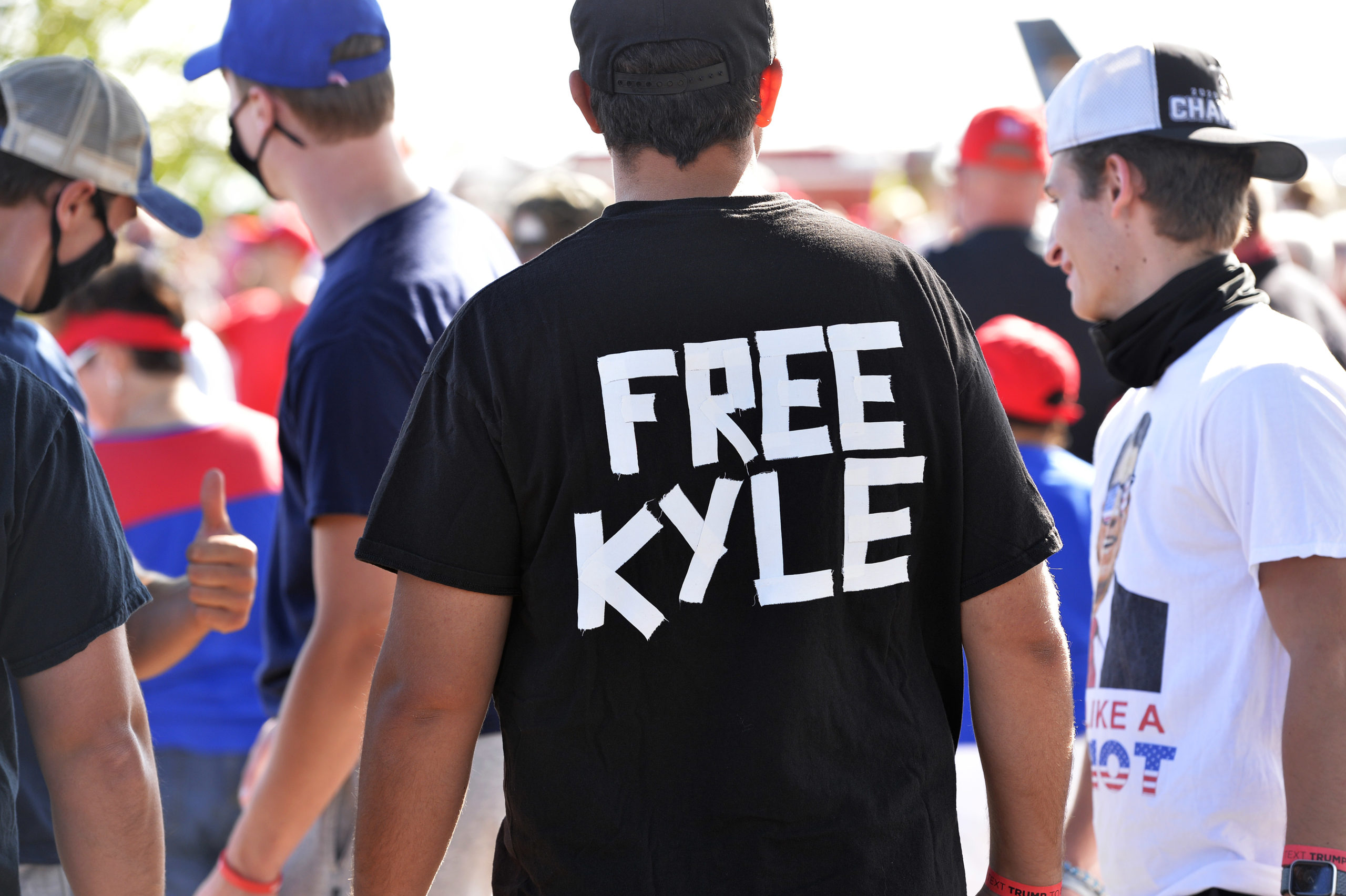 A man wears a shirt calling for freedom for Kyle Rittenhouse, 17, the man who allegedly shot protesters in Wisconsin, during a US President Donald Trump Campaign Rally, the day after the end of the Republican National Convention, at Manchester airport in Londonderry, New Hampshire on August 28, 2020. (JOSEPH PREZIOSO/AFP via Getty Images)