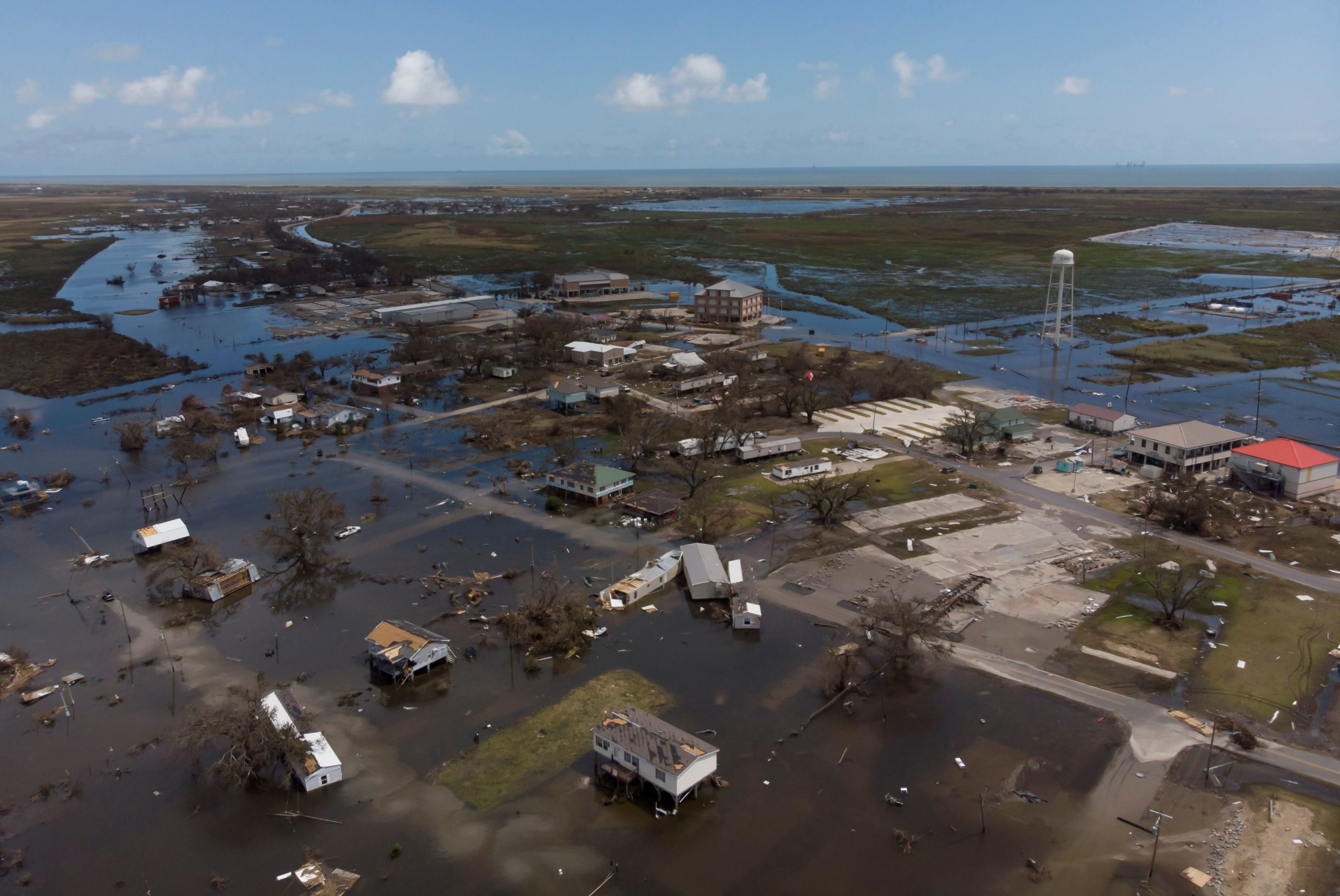 An aerial view shows homes that were destroyed by Hurricane Laura on August 29, 2020 in Cameron, Louisiana. - At least 14 people were killed after Hurricane Laura slammed into the southern US states of Louisiana and Texas, authorities and local media said on August 28. (Photo by Stringer/AFP via Getty Images)