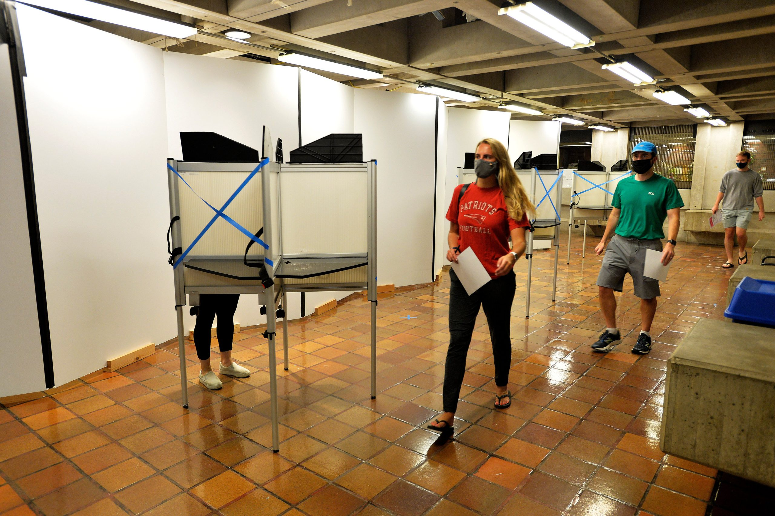 Voters with their ballots leave the polling booths at Boston City Hall during the Massachusetts State Primary on September 1, 2020 in Boston, Massachusetts. (Photo by Joseph Prezioso / AFP) (Photo by JOSEPH PREZIOSO/AFP via Getty Images)
