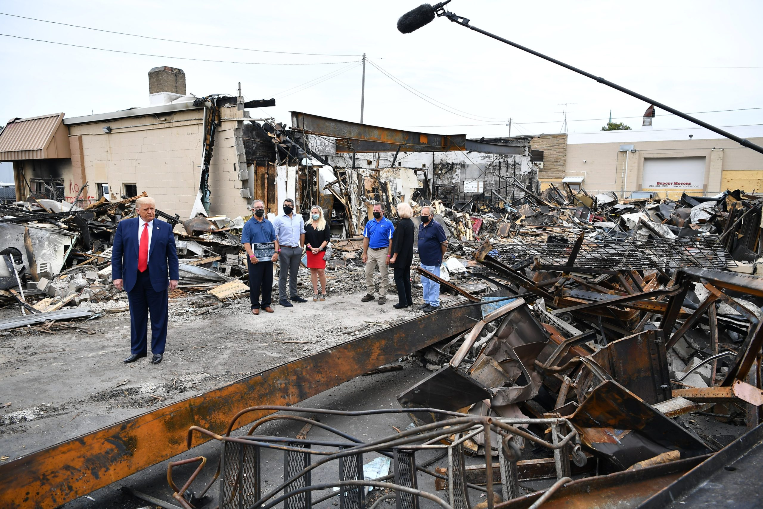 US President Donald Trump (L) tours an area affected by civil unrest in Kenosha, Wisconsin on September 1, 2020. - Trump visited Kenosha, the Wisconsin city at the center of a raging US debate over racism, despite pleas to stay away and claims he is dangerously fanning tensions as a reelection ploy. (MANDEL NGAN/AFP via Getty Images)