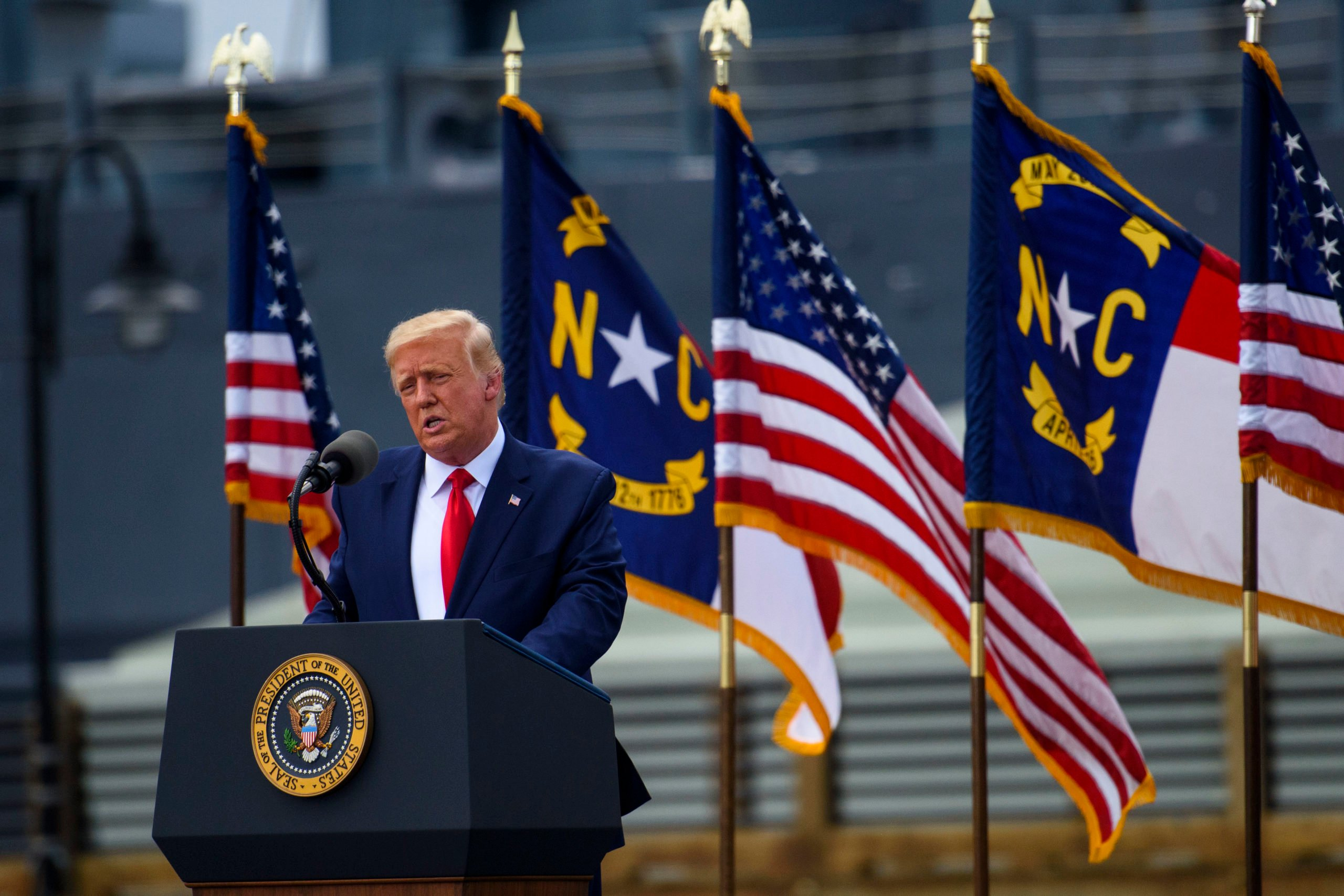 WILMINGTON, NC - SEPTEMBER 02: President Donald Trump speaks to a small crowd outside the USS North Carolina on September 2, 2020 in Wilmington, North Carolina. President Donald Trump visited the port city for a brief ceremony designating Wilmington as the nation's first WWII Heritage City. The title is in honor of the area's efforts during WWII. (Photo by Melissa Sue Gerrits/Getty Images)