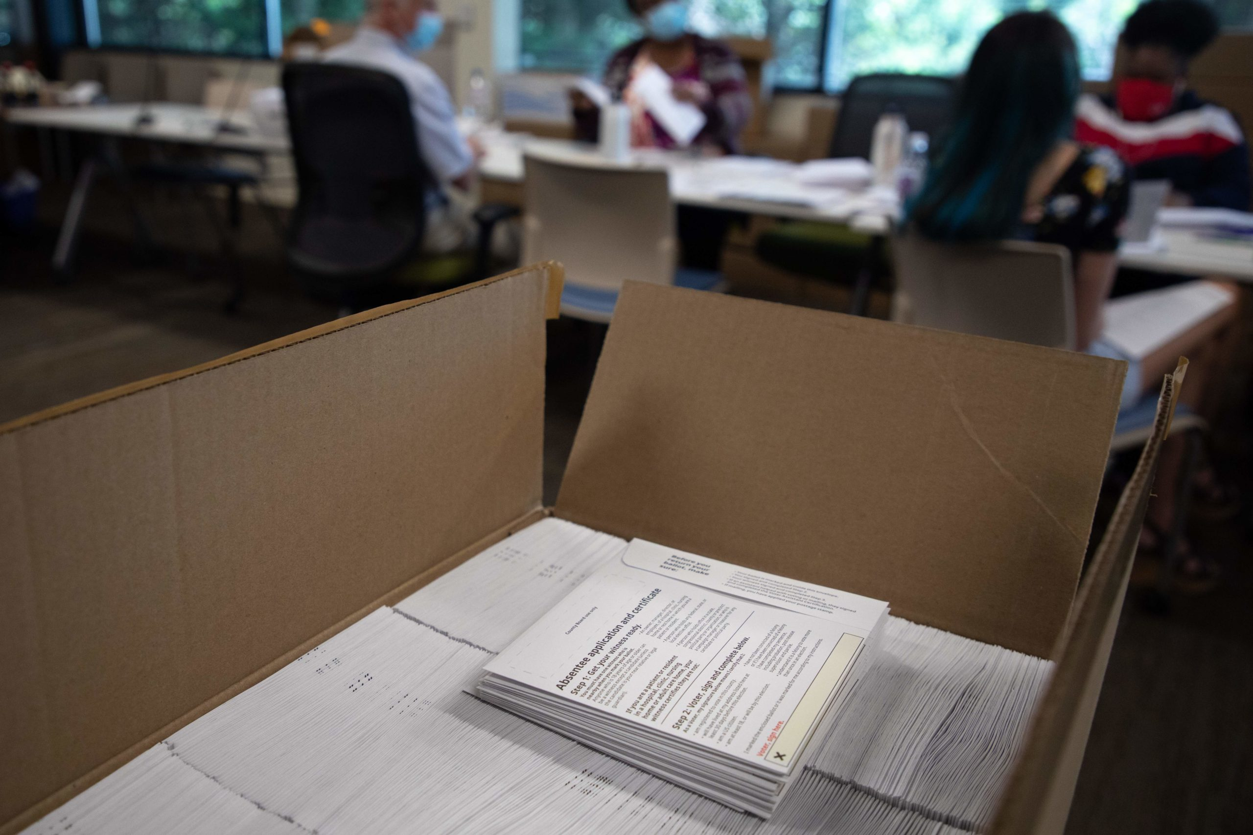 Paperwork sits in a box as absentee ballot election workers stuff ballot applications at the Mecklenburg County Board of Elections office in Charlotte, North Carolina on September 4, 2020. (LOGAN CYRUS/AFP via Getty Images)
