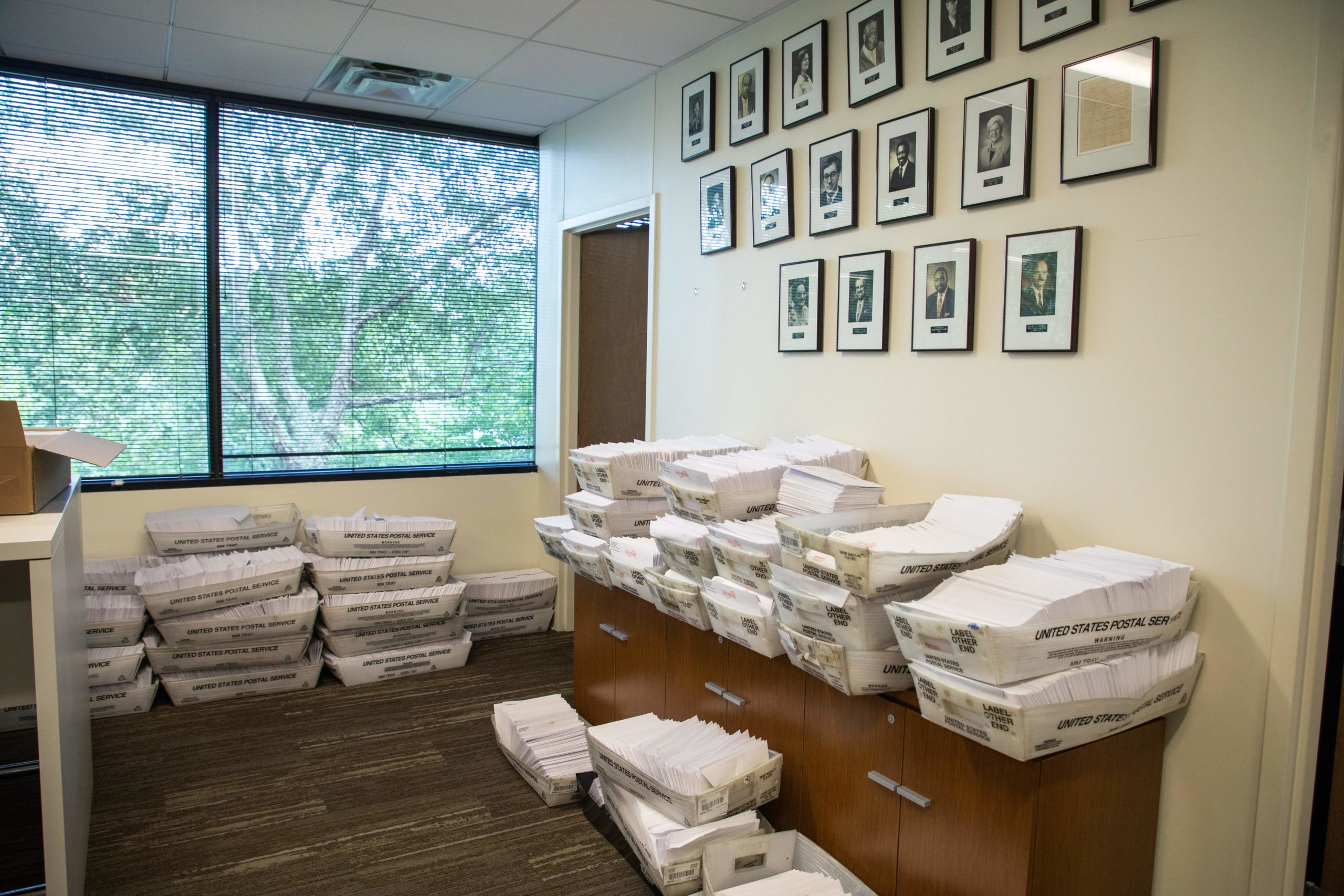 Large boxes of envelopes are seen as absentee ballot election workers stuff ballot applications at the Mecklenburg County Board of Elections office in Charlotte, North Carolina on September 4, 2020. - The US election is officially open: North Carolina on September 4, 2020 launched vote-by-mail operations for the November 3 contest between President Donald Trump and Joe Biden, which is getting uglier by the day. Worries about the unabated spread of the coronavirus are expected to prompt a major increase in the number of ballots cast by mail, as Americans avoid polling stations. (Photo by Logan Cyrus / AFP) (Photo by LOGAN CYRUS/AFP via Getty Images)