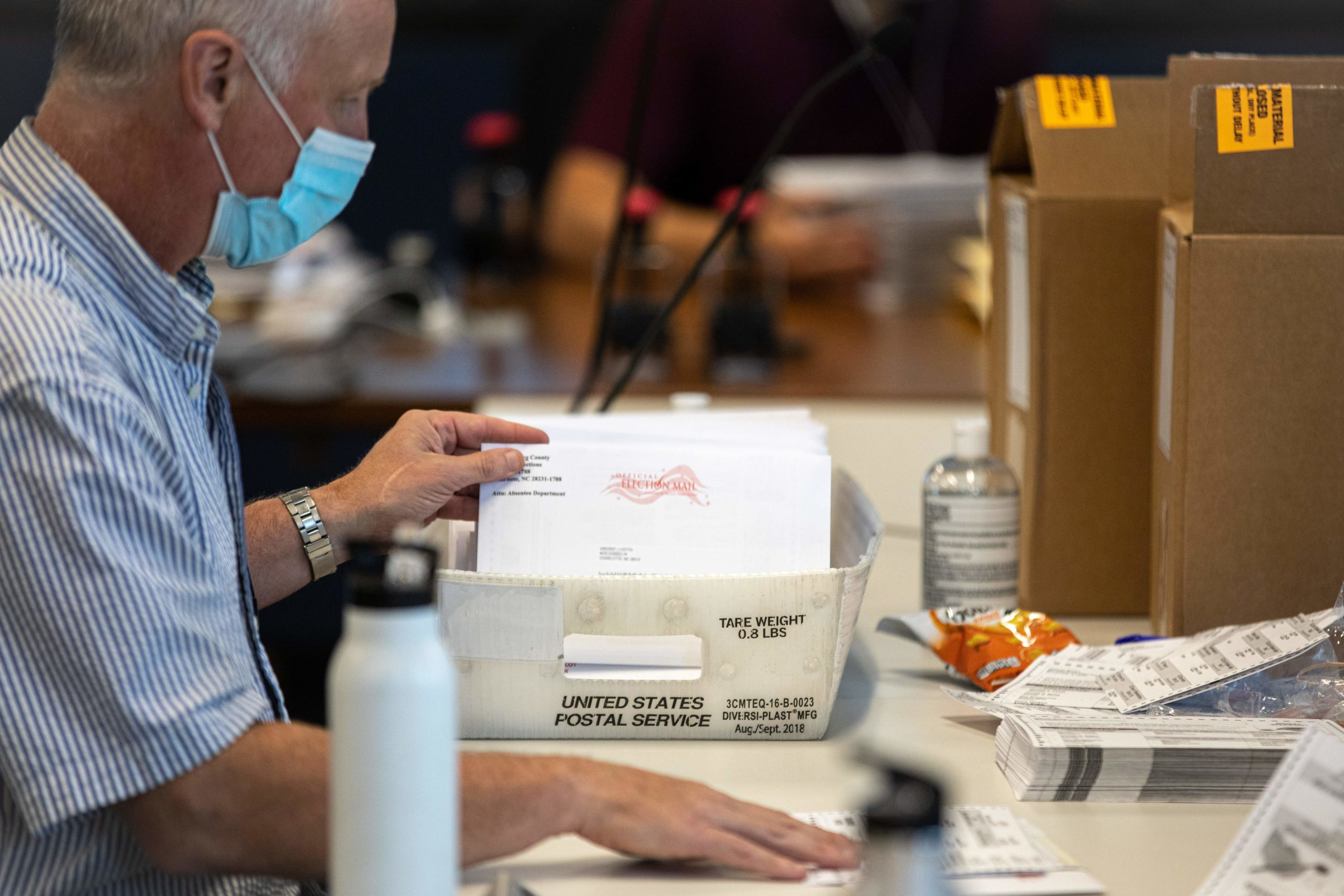 Absentee ballot election workers stuff ballot applications at the Mecklenburg County Board of Elections office in Charlotte, North Carolina on September 4, 2020. (LOGAN CYRUS/AFP via Getty Images)