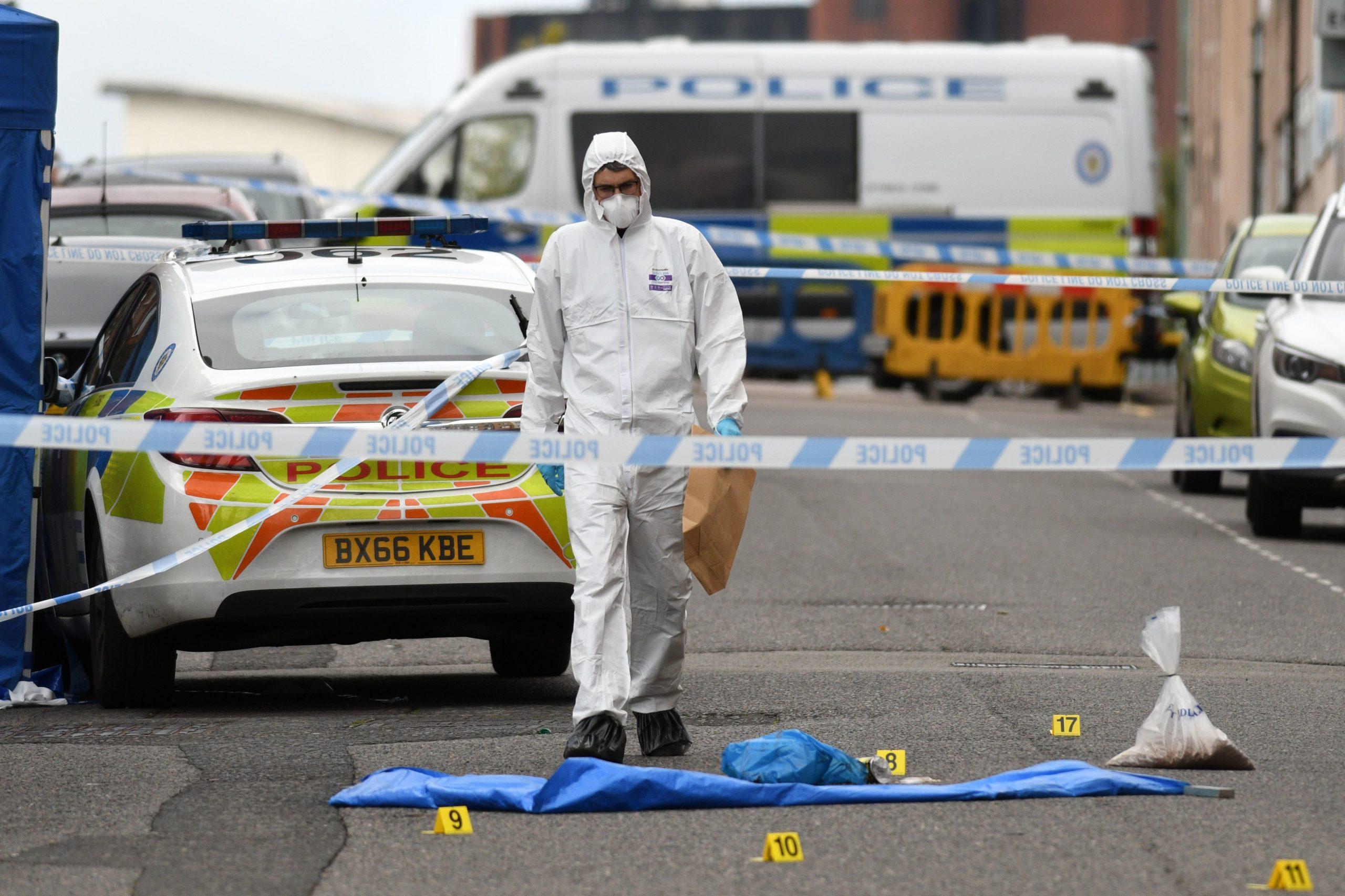 A police forensics officer gathers evidence near to evidence markers inside a cordon on Irving Street, following a major stabbing incident in the centre of Birmingham, central England, on September 6, 2020.(Photo by Oli SCARFF / AFP)