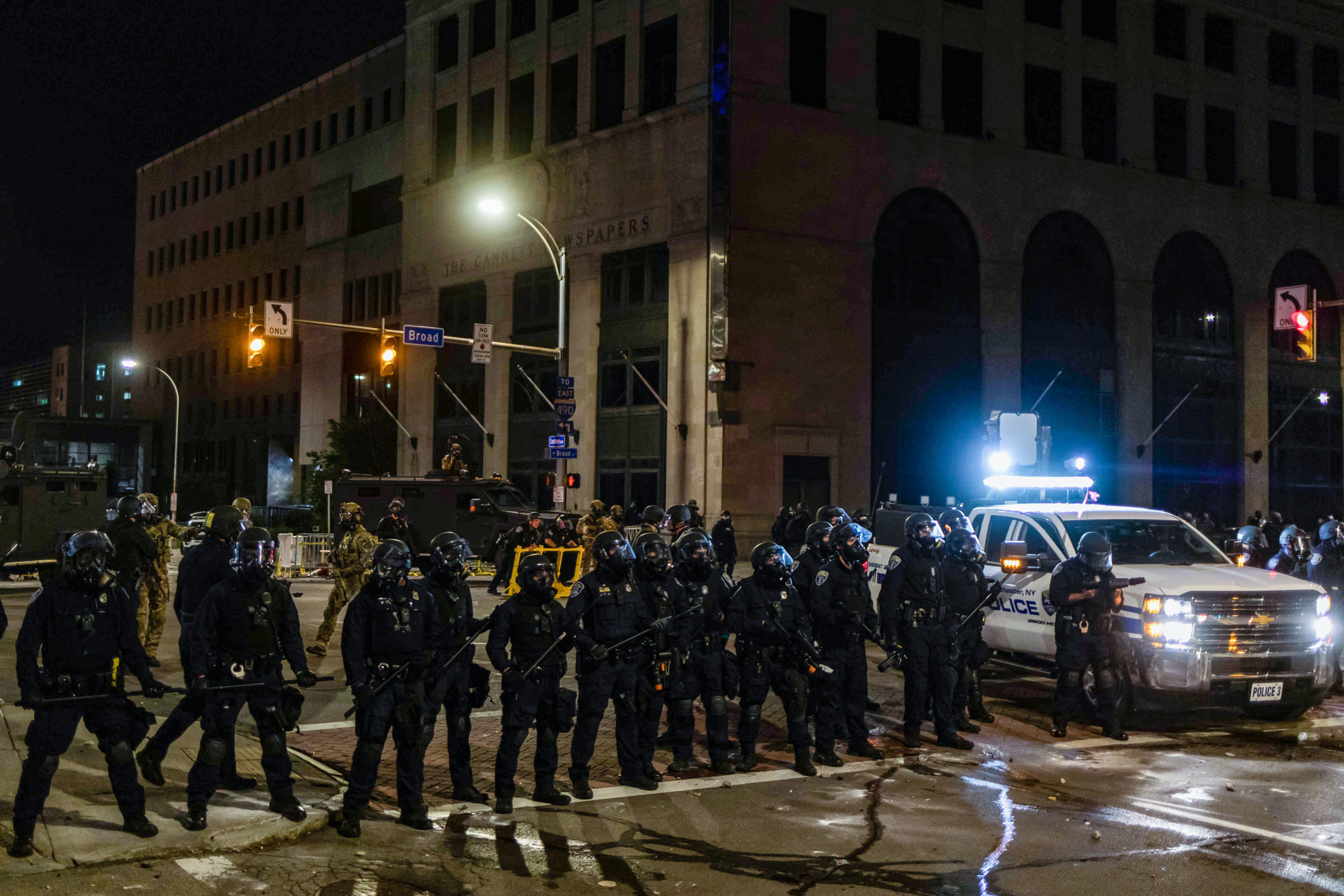 Rochester Police in riot gear stand in Rochester, New York, on September 5, 2020, on the fourth night of protest following the release of video showing the death of Daniel Prude. - Prude, a 41-year-old African American who had mental health issues, died of asphyxiation after police arrested him on March 23, 2020, in Rochester. (MARANIE R. STAAB/AFP via Getty Images)