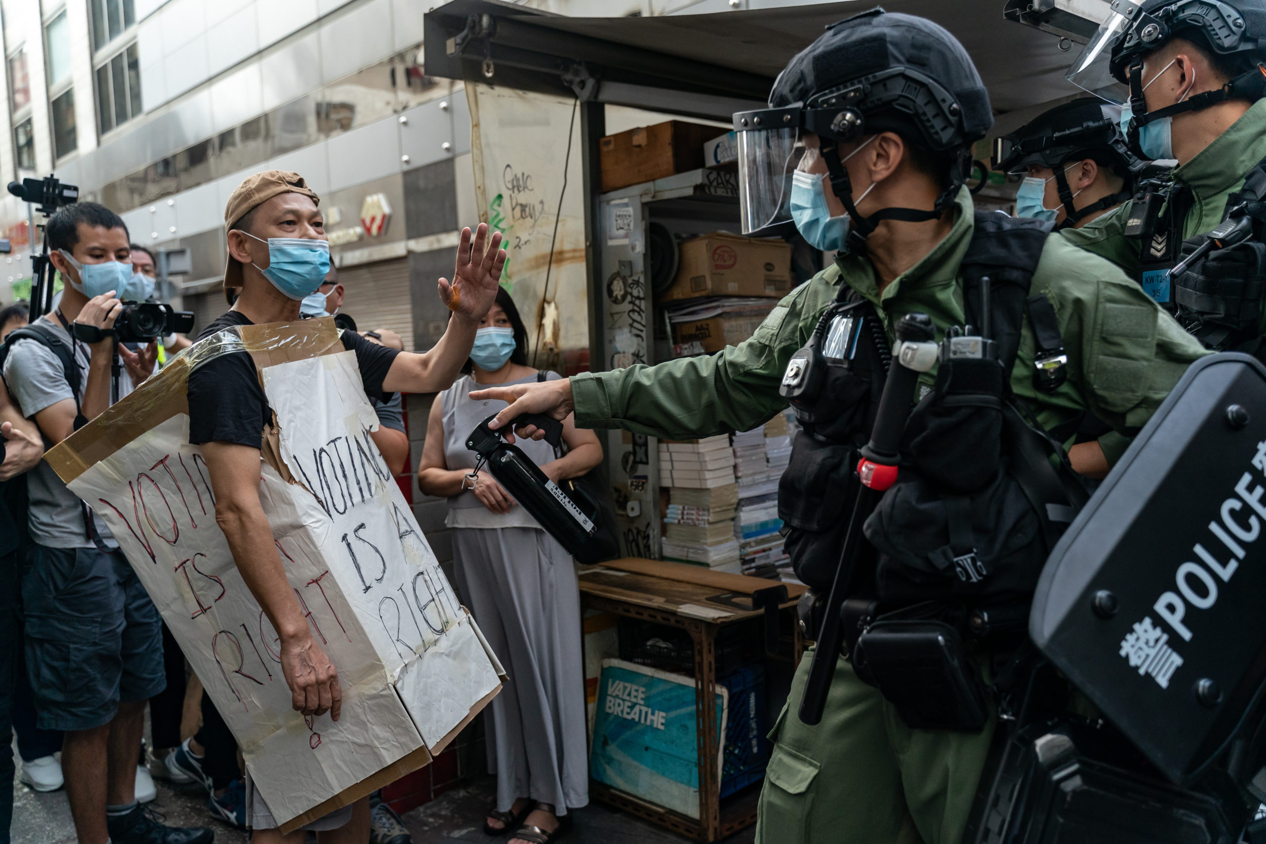 HONG KONG, CHINA - SEPTEMBER 06: A man wearing a Voting Is A Right costome stand off with riot police during an anti-government protest on September 6, 2020 in Hong Kong, China. Nearly 300 people were arrested during the protest against the government's decision to postpone the legislative council election due to the Covid-19 and the newly imposed national security law. (Photo by Anthony Kwan/Getty Images)