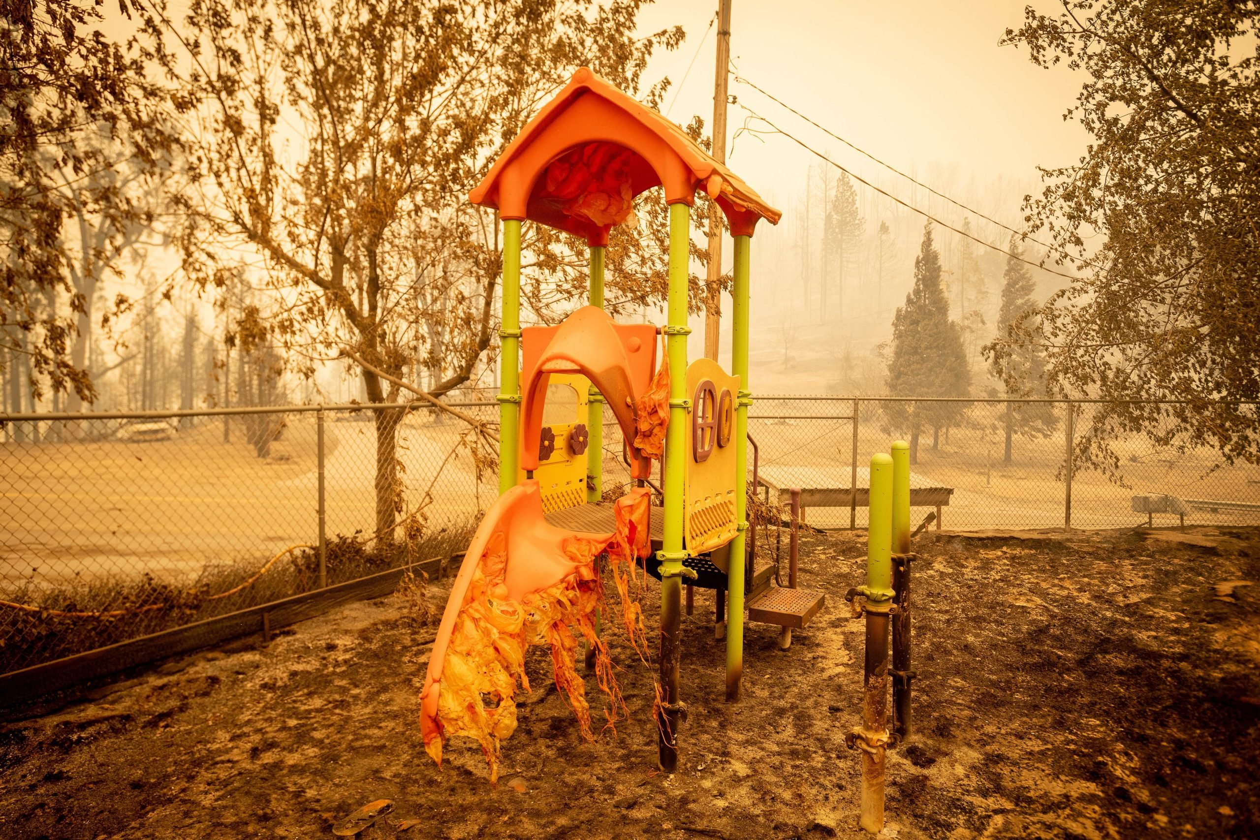 A melted slide smolders as a playground continues to burn at Pine Ridge school during the Creek fire in an unincorporated area of Fresno County, California on September 08, 2020. - Wildfires in California have torched a record more than two million acres, the state fire department said on September 7, as smoke hampered efforts to airlift dozens of people trapped by an uncontrolled blaze. (Photo by JOSH EDELSON/AFP via Getty Images)