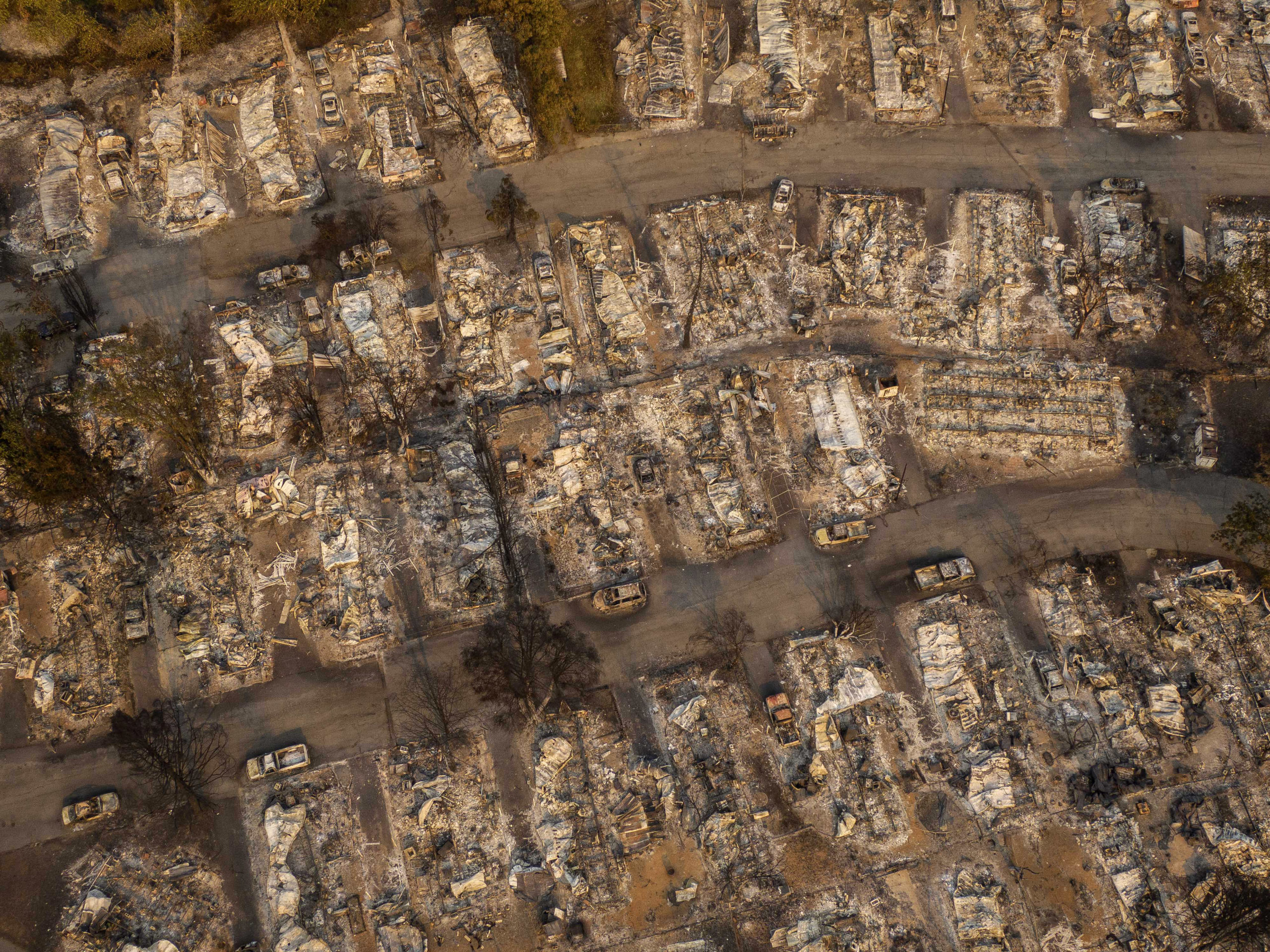 In this aerial view from a drone, a mobile home park destroyed by fire is shown on September 10, 2020 in Phoenix, Oregon. (David Ryder/Getty Images)
