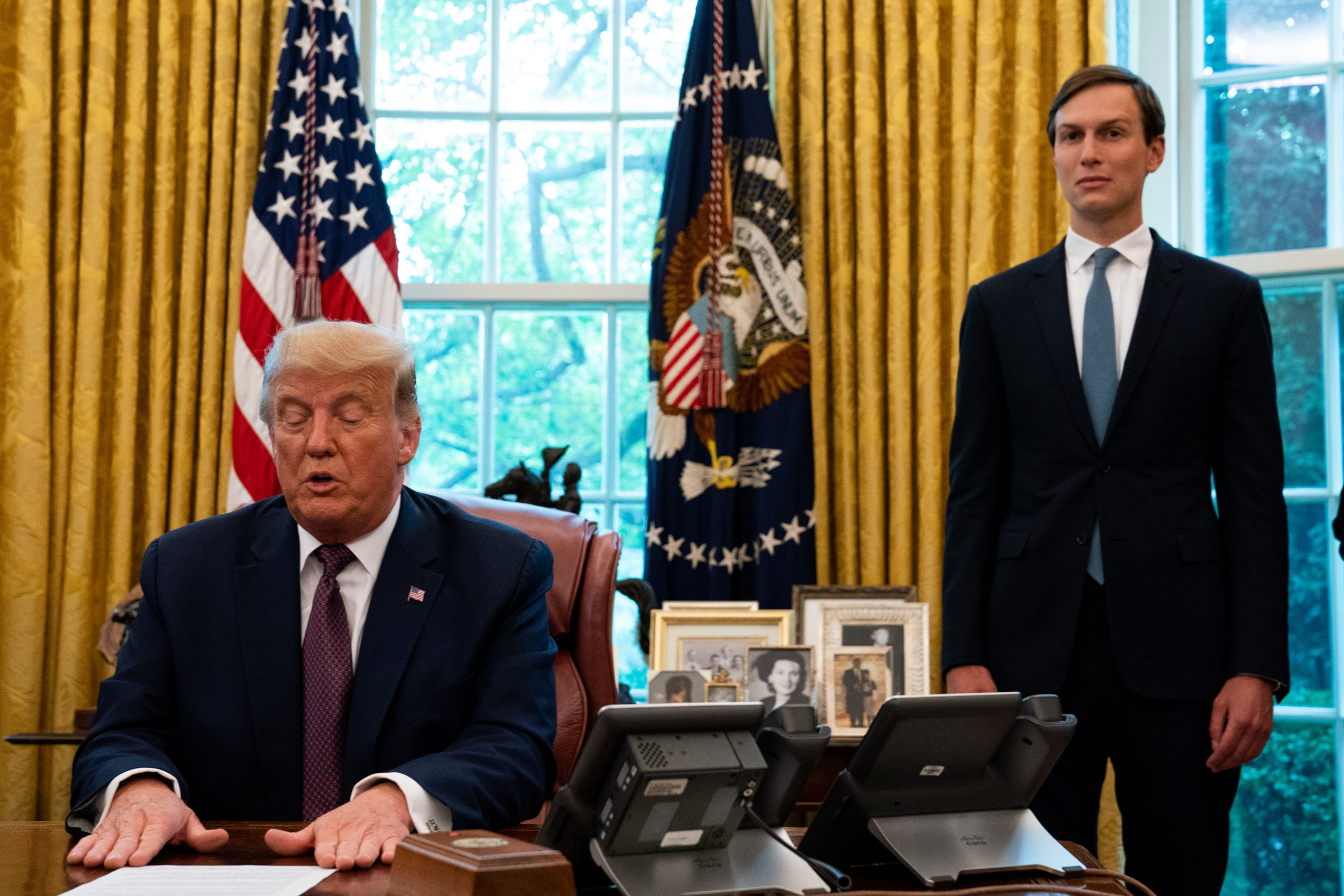 WASHINGTON, DC - SEPTEMBER 11: Advisor Jared Kushner (R) looks on as U.S. President Donald Trump speaks in the Oval Office to announce that Bahrain will establish diplomatic relations with Israel, at the White House in Washington, DC on September 11, 2020. The announcement follows one last month by Israel and the United Arab Emirates that they would seek to normalize relations with each other. (Photo by Anna Moneymaker-Pool/Getty Images)