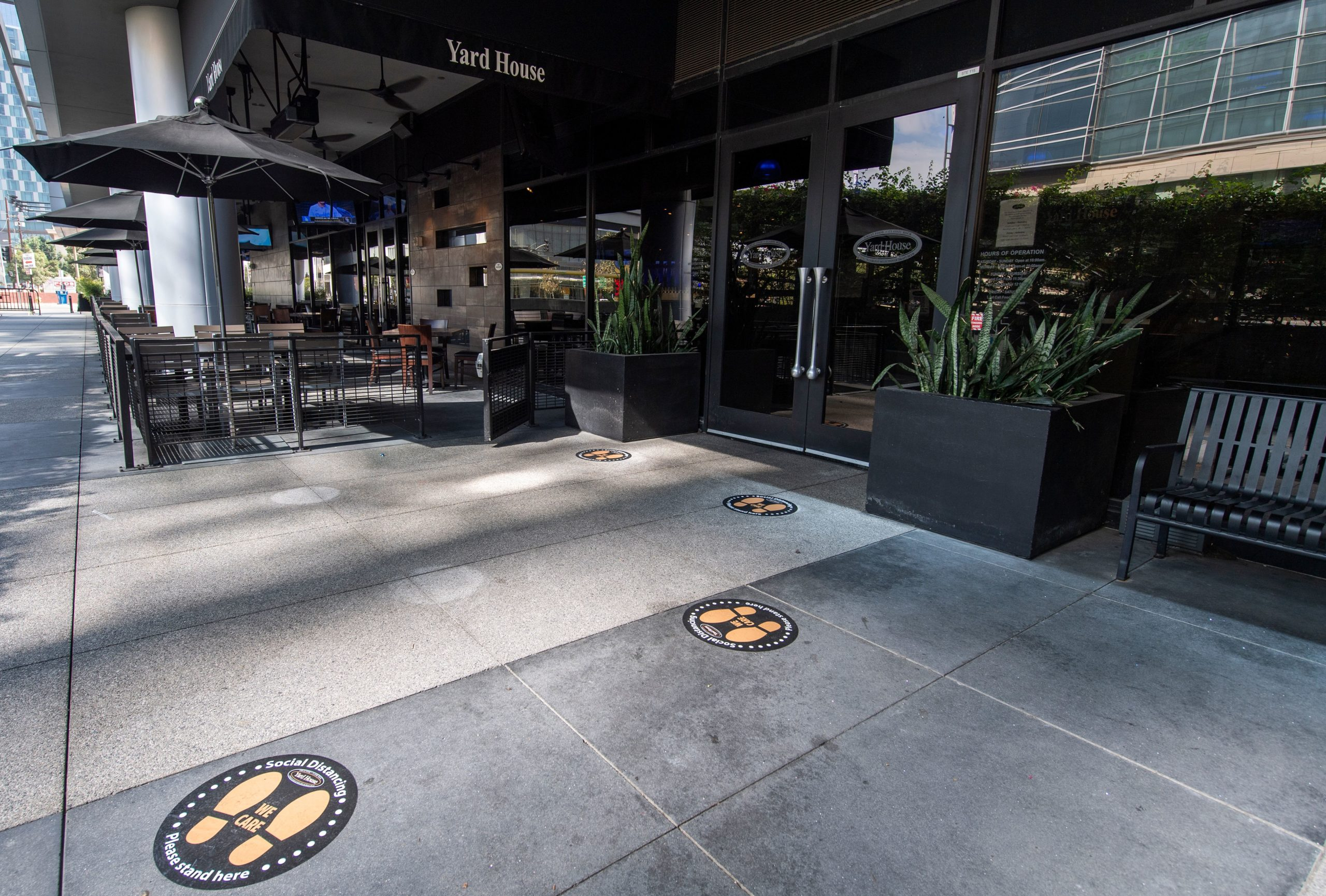 Footprints are marked for safety distancing in front of a restaurant during the coronavirus pandemic, September 18, 2020, in Los Angeles California. (Photo by VALERIE MACON / AFP) (Photo by VALERIE MACON/AFP via Getty Images)
