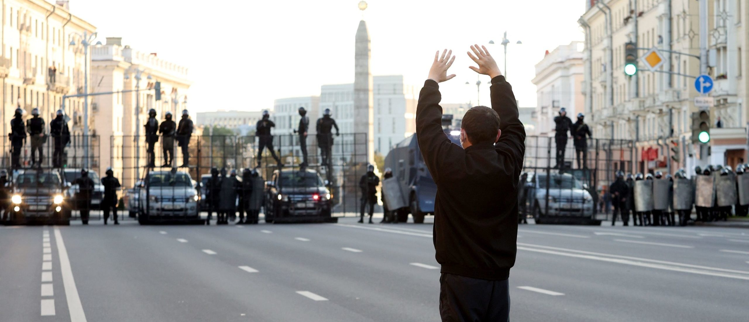 A man gestures as he stands in front of law enforcement officers blocking the road during a demonstration called by opposition movement for an end to the regime of authoritarian leader in Minsk on September 20, 2020. - Belarus President Alexander Lukashenko, who has ruled the ex-Soviet state for 26 years, claimed to have defeated opposition leader Svetlana Tikhanovskaya with 80 percent of the vote in the August 9, elections. (Photo by - / AFP) (Photo by -/AFP via Getty Images)