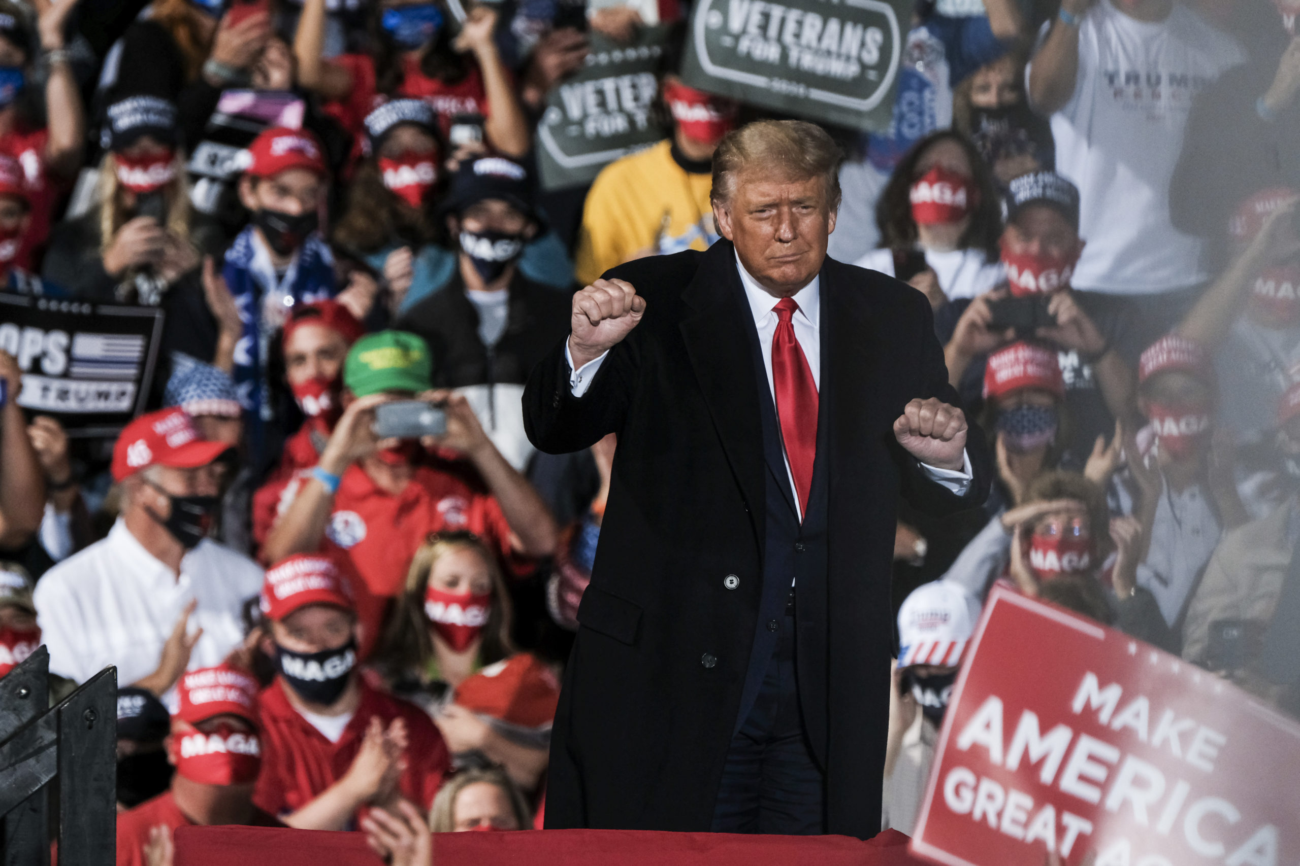 SWANTON, OH - SEPTEMBER 21: President Donald Trump charges up the crowd while speaking of the need to win the upcoming election during a campaign rally at the Toledo Express Airport on September 21, 2020 in Swanton, Ohio. Through the rally the President both expressed the importance of filling the late Supreme Court Justice Ruth Bader Ginsberg's seat as well as his perceived consequences to America if his opponent Joe Biden were to win in the upcoming election. (Photo by Matthew Hatcher/Getty Images)