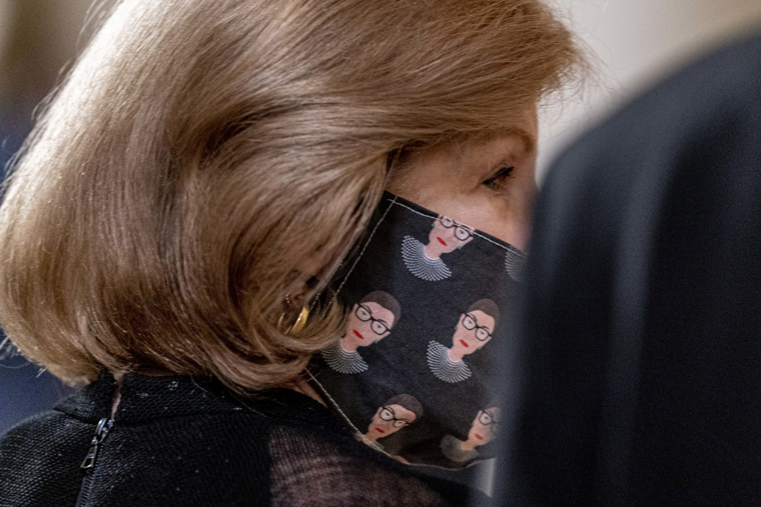 NPR Supreme Court reporter Nina Totenberg wears a face mask with depictions of Justice Ruth Bader Ginsburg on it during a private ceremony for Justice Ginsburg, on September 23, 2020 in Washington, DC. Ginsburg, who was appointed by former U.S. President Bill Clinton served on the high court from 1993, until her death on September 18, 2020. (Andrew Harnik-Pool/Getty Images)