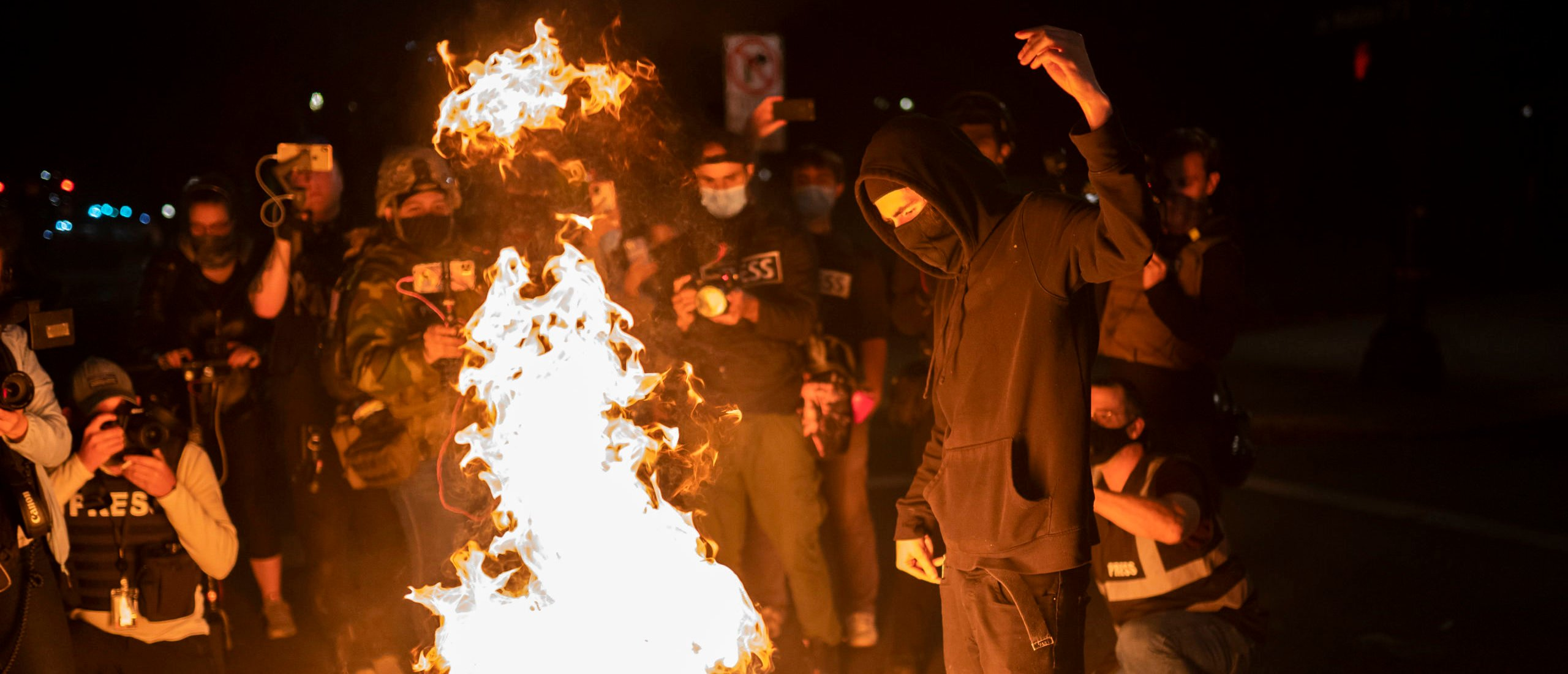PORTLAND, OR - SEPTEMBER 26: A protester burns an American flag on September 26, 2020 in Portland, Oregon. Oregon Governor Kate Brown declared a state of emergency prior to Saturday's protest and Proud Boy rally, as fears of political violence between far-right groups and Black Lives Matter protesters grew. (Nathan Howard/Getty Images)