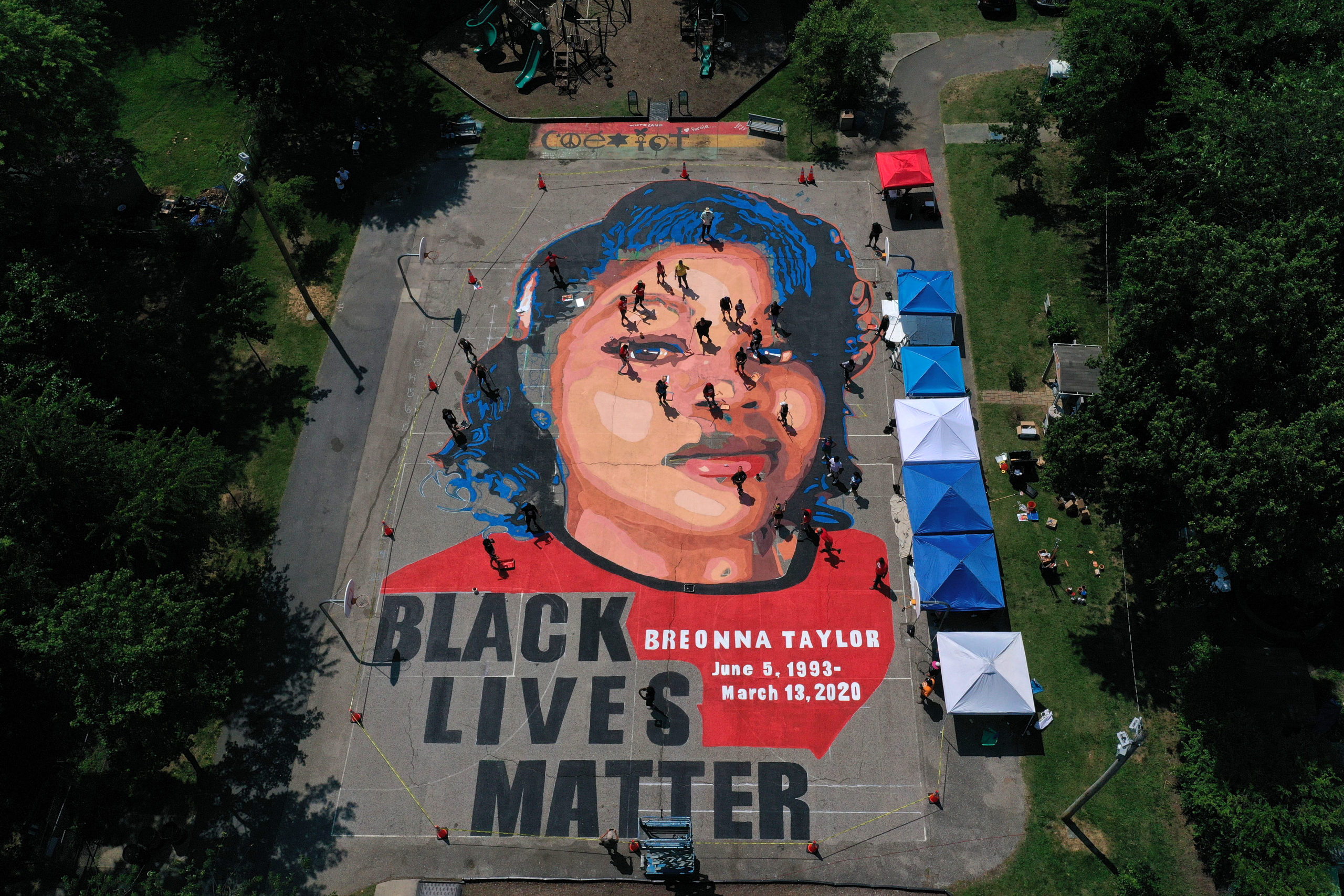 ANNAPOLIS, MARYLAND - JULY 05: In an aerial view from a drone, a large-scale ground mural depicting Breonna Taylor with the text 'Black Lives Matter' is seen being painted at Chambers Park on July 5, 2020 in Annapolis, Maryland. The mural was organized by Future History Now in partnership with Banneker-Douglass Museum and The Maryland Commission on African American History and Culture. The painting honors Breonna Taylor, who was shot and killed by members of the Louisville Metro Police Department in March 2020. (Photo by Patrick Smith/Getty Images)