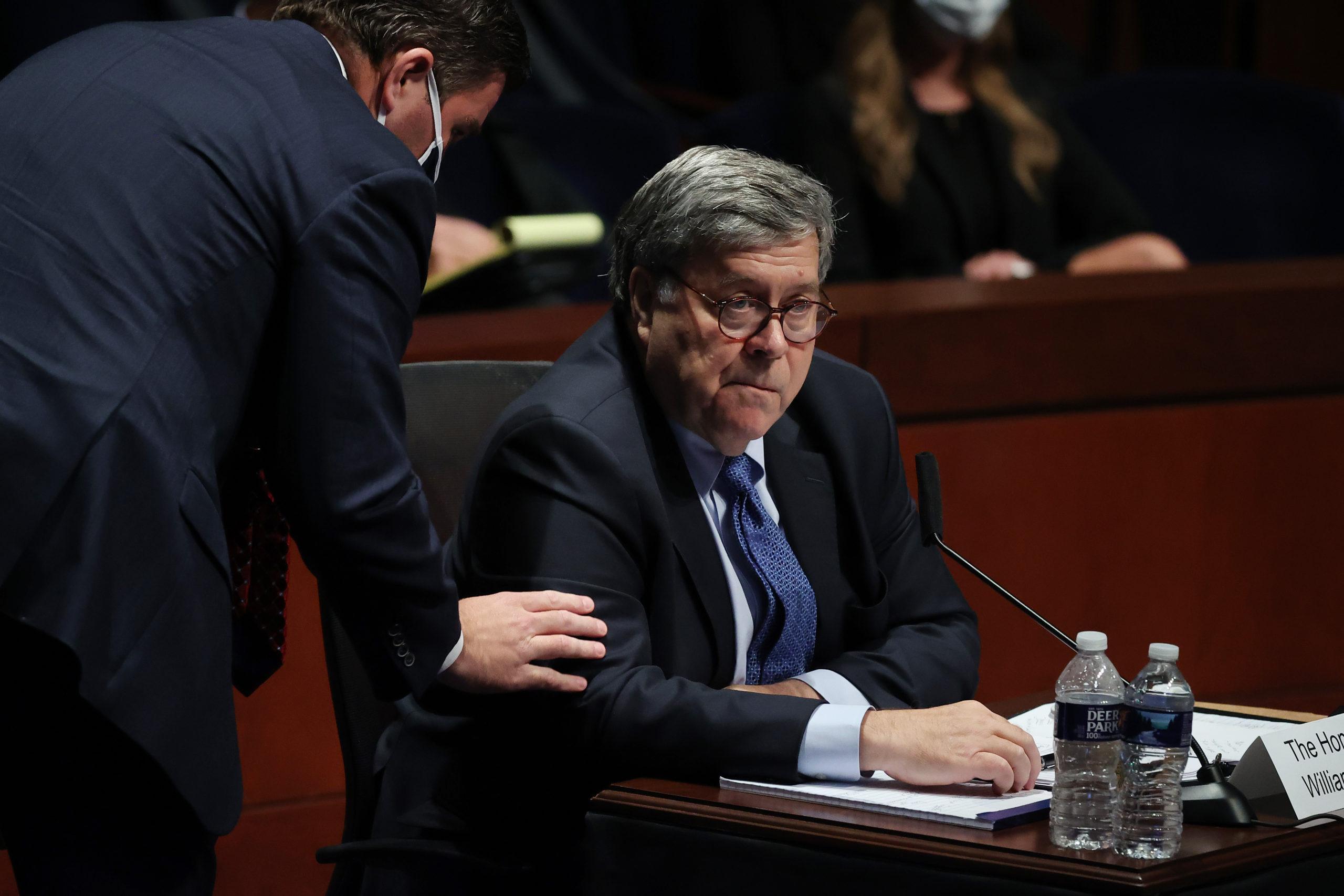U.S. Attorney General William Barr hears from Assistant Attorney General for Legislative Affairs Stephen Boyd as Barr testifies before the House Judiciary Committee in the Congressional Auditorium at the U.S. Capitol Visitors Center July 28, 2020 in Washington, DC. (Chip Somodevilla/Getty Images)