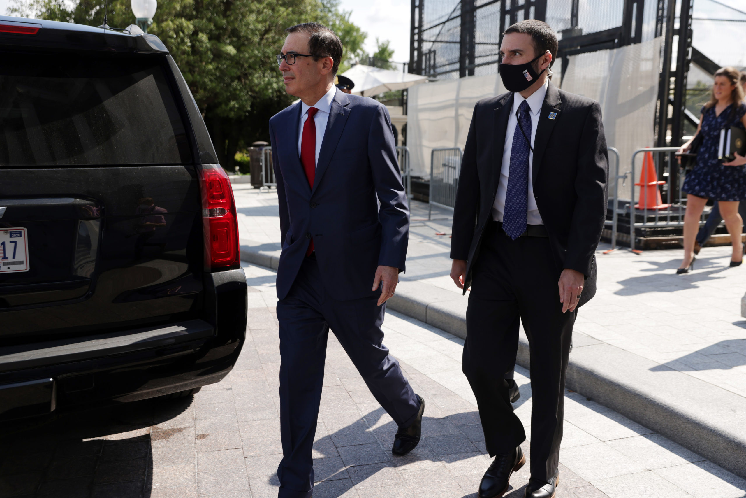 WASHINGTON, DC - AUGUST 07: U.S. Secretary of the Treasury Steven Mnuchin leaves after a meeting at the office of Speaker of the House Rep. Nancy Pelosi (D-CA) at the U.S. Capitol on August 7, 2020 in Washington, DC. Treasury Secretary Steven Mnuchin, Speaker of the House Rep. Nancy Pelosi, Senate Minority Leader Sen. Chuck Schumer and White House Chief of Staff Mark Meadows were unable to reach a deal on a new relief package to help people weather the COVID-19 pandemic. (Photo by Alex Wong/Getty Images)