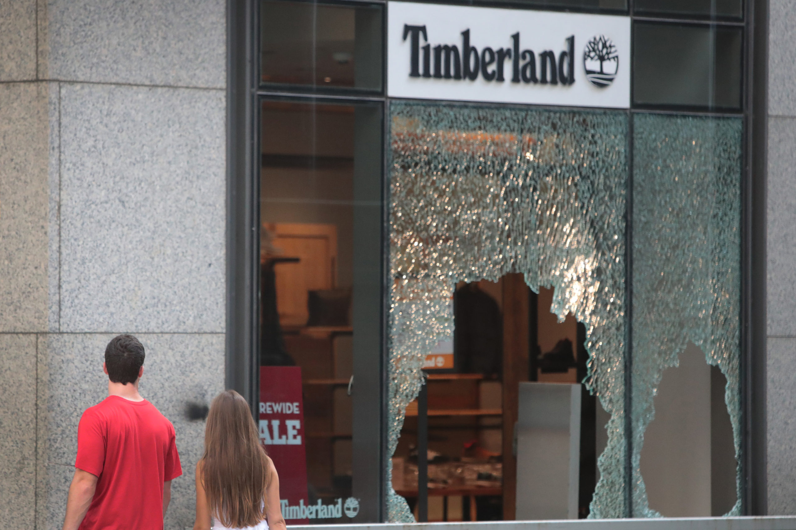 CHICAGO, ILLINOIS - AUGUST 10: A window is shattered at a Timberland store along Michigan Avenue after it was looted on August 10, 2020 in Chicago, Illinois. Police made several arrests during the night as widespread looting was reported downtown and other areas of the city. (Photo by Scott Olson/Getty Images)